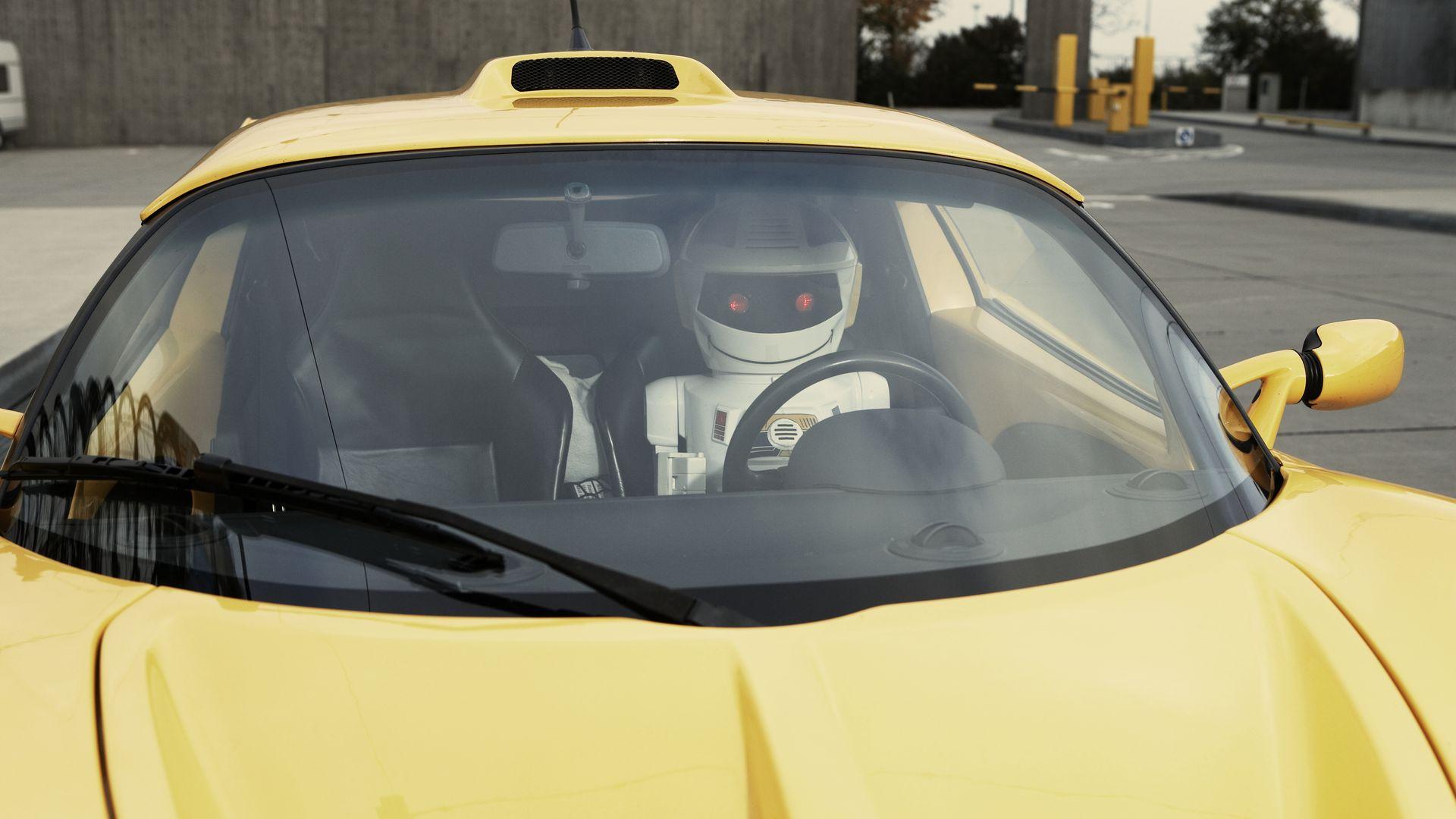 A robot driving a car