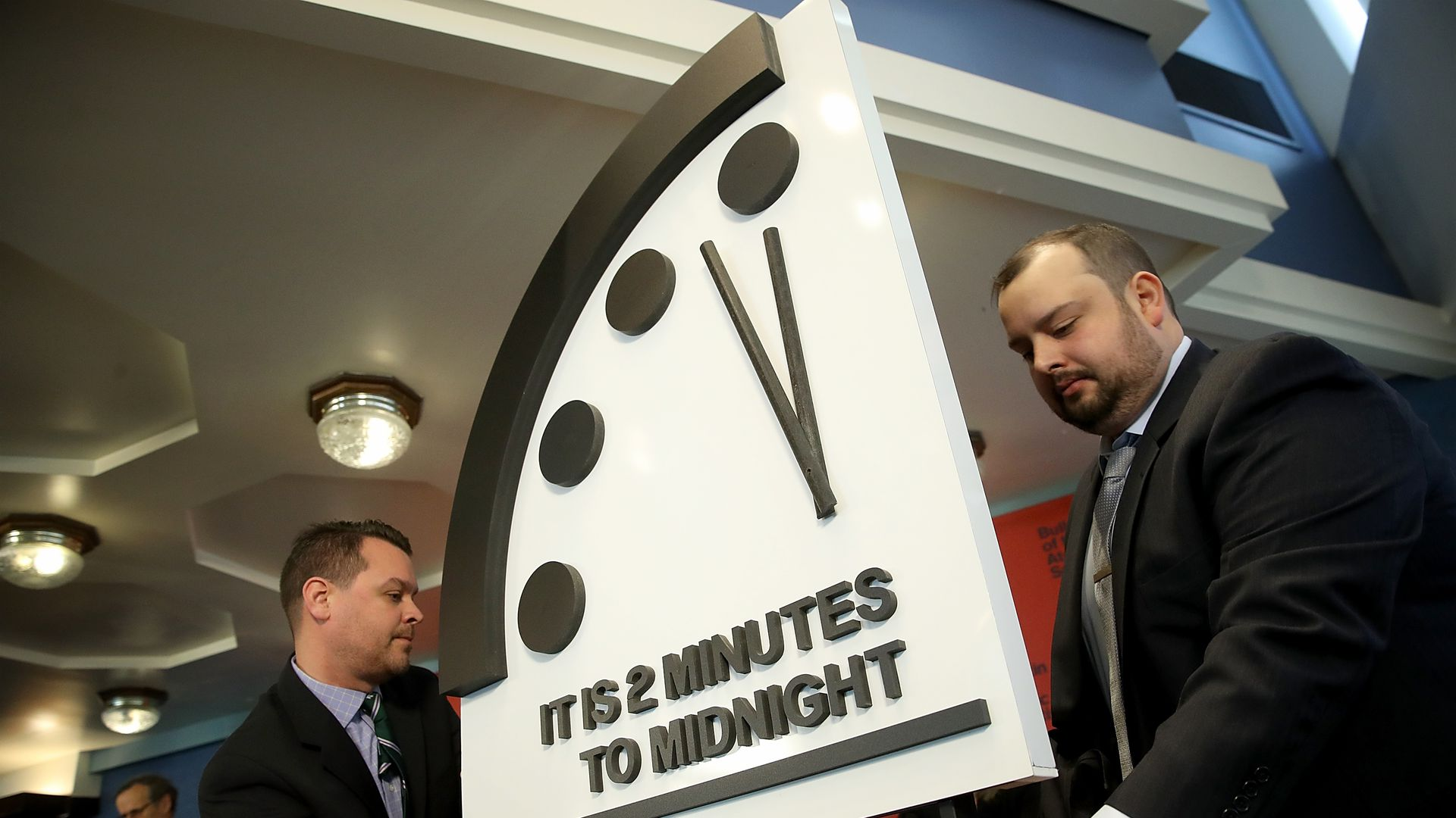 "The doomsday clock, reading ""it is 2 minutes to midnight"""