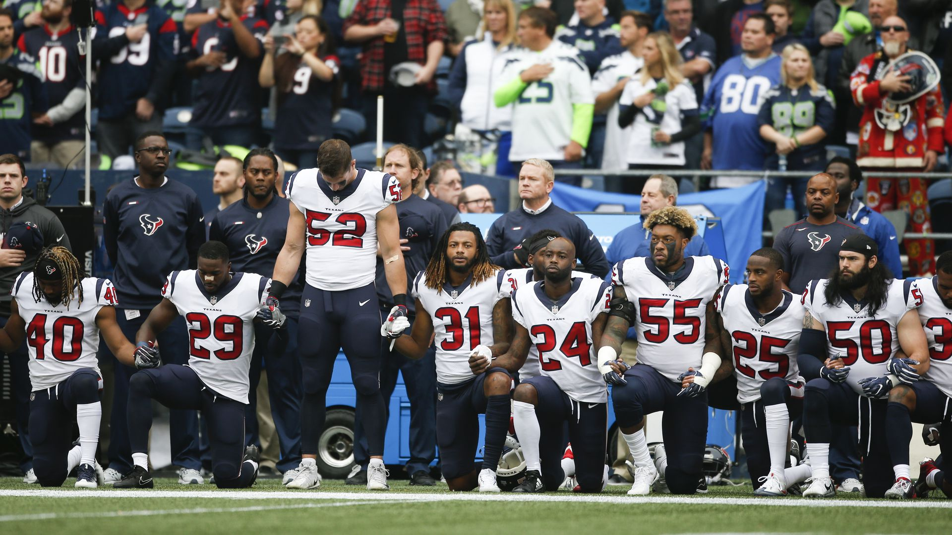 Members of the Houston Texans kneel during the national anthem