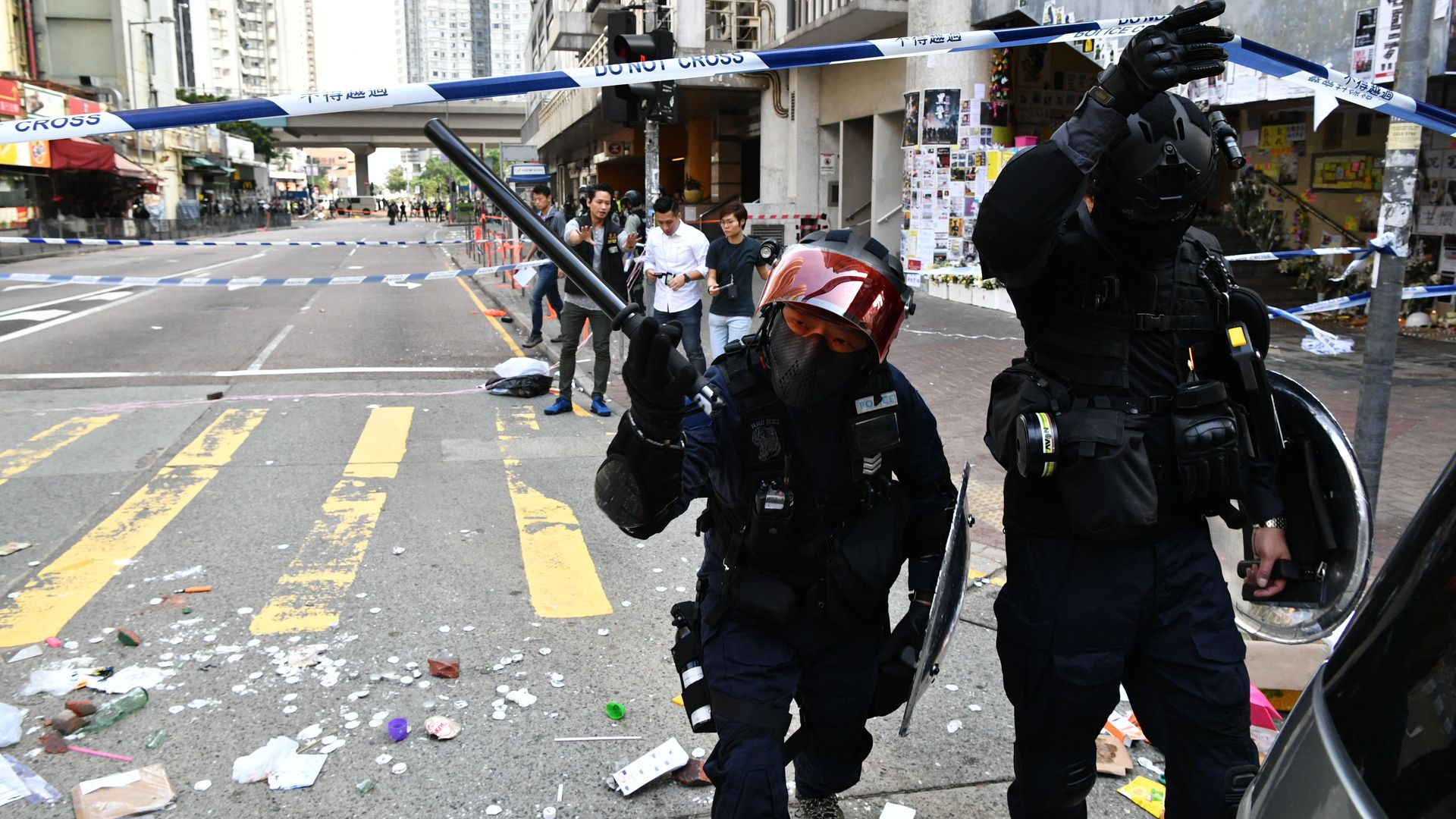 Hong Kong protester shot by police, video shows