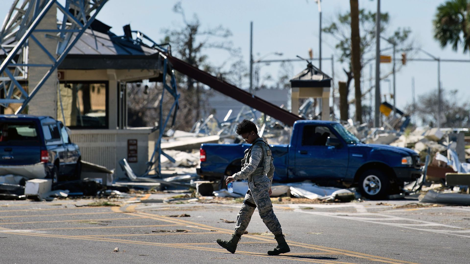 A military police officer patrols Tyndall Air Force Base in the wake of Hurricane Michael.