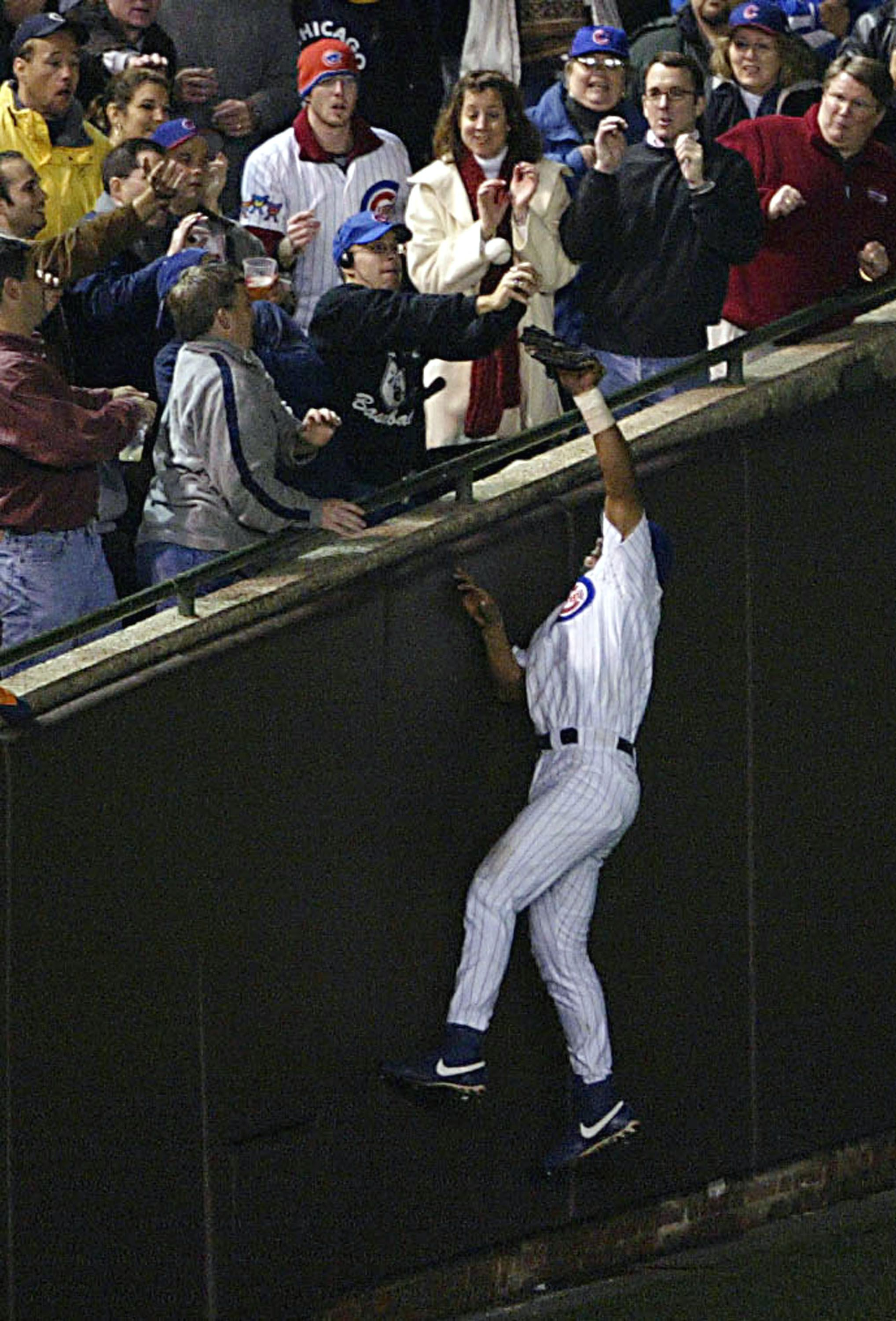 Fan interferes with Cubs player