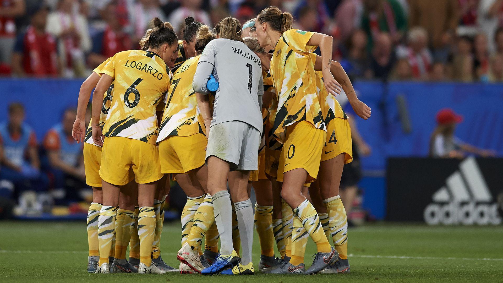 The Australian womens soccer team huddles before a match.