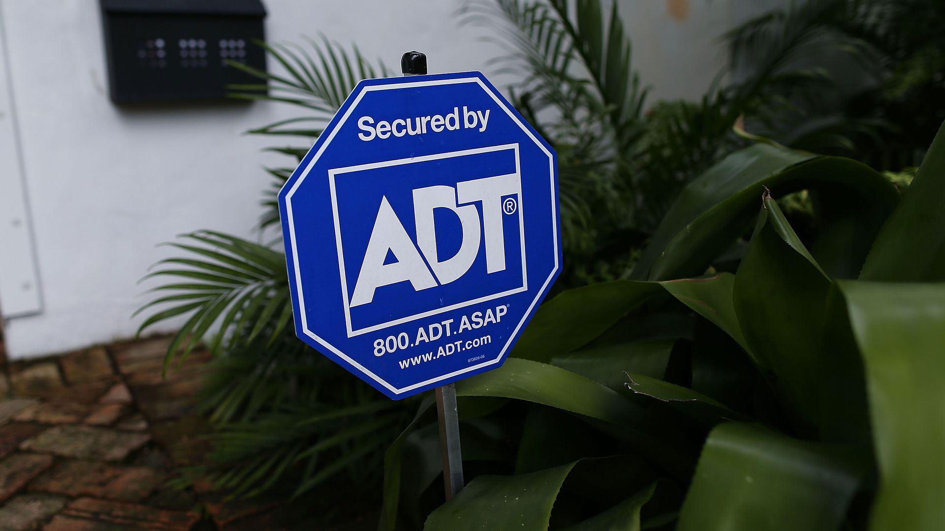 ADT security sign outside of a home.