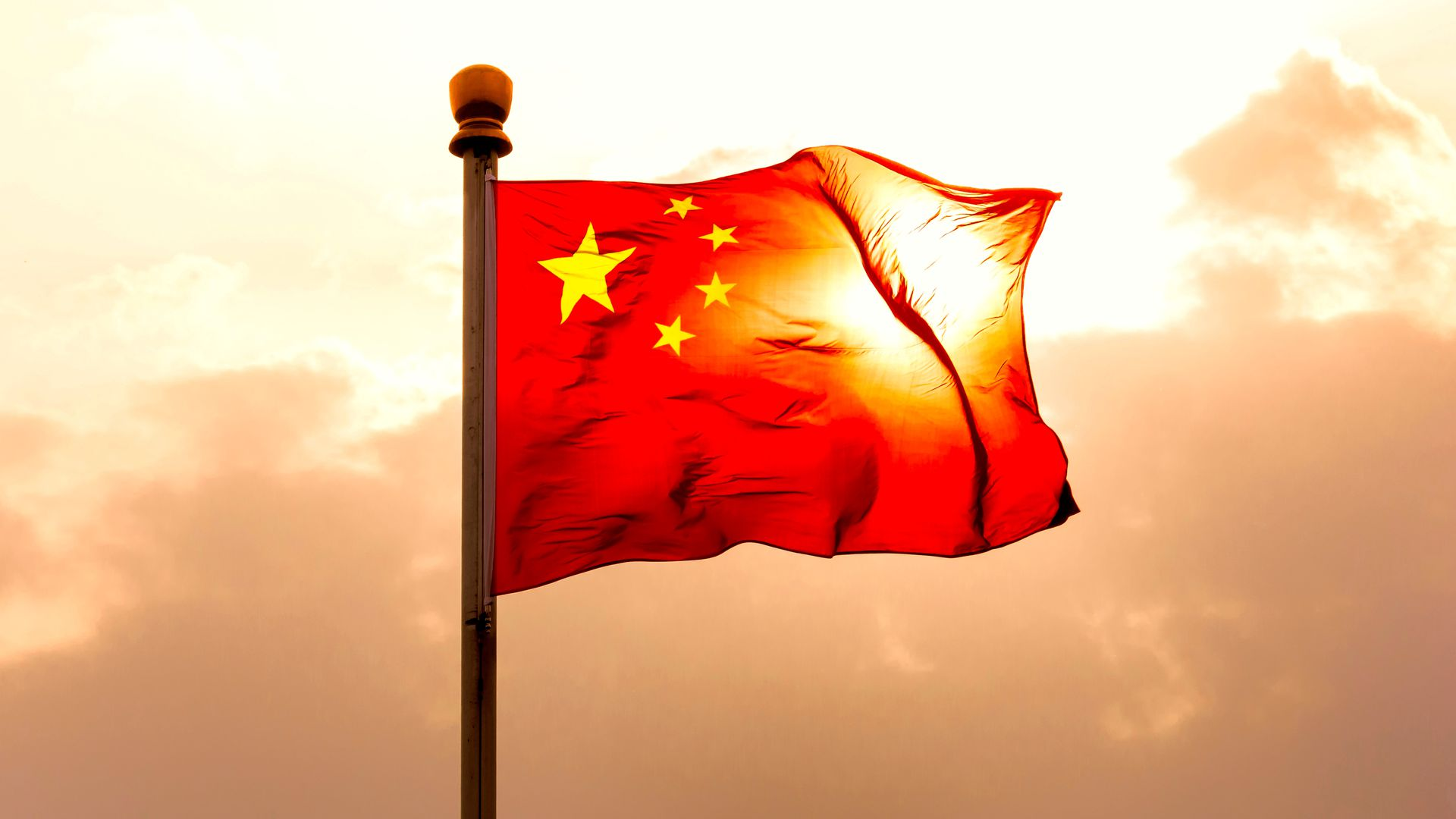 Photo of Chinese flag waving in sky