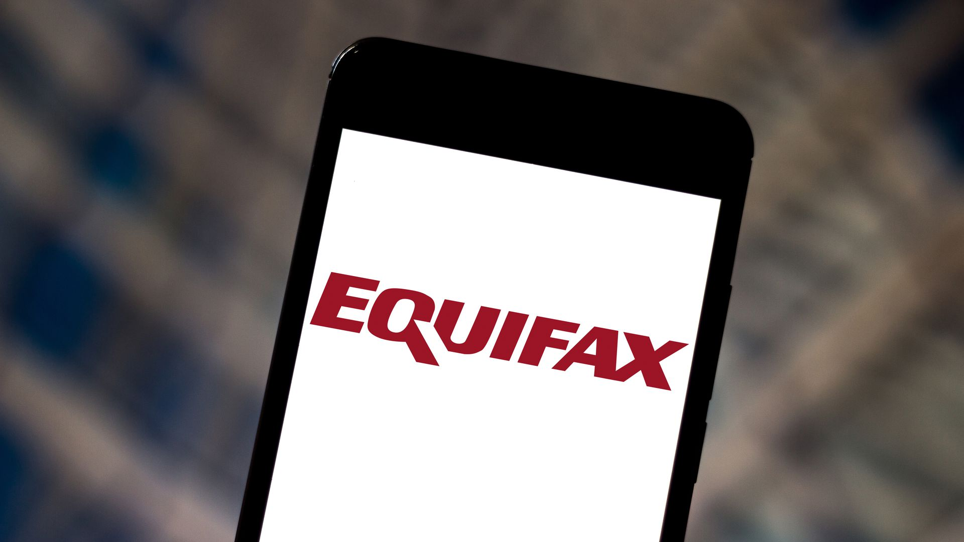 This image shows a phone with the Equifax logo.