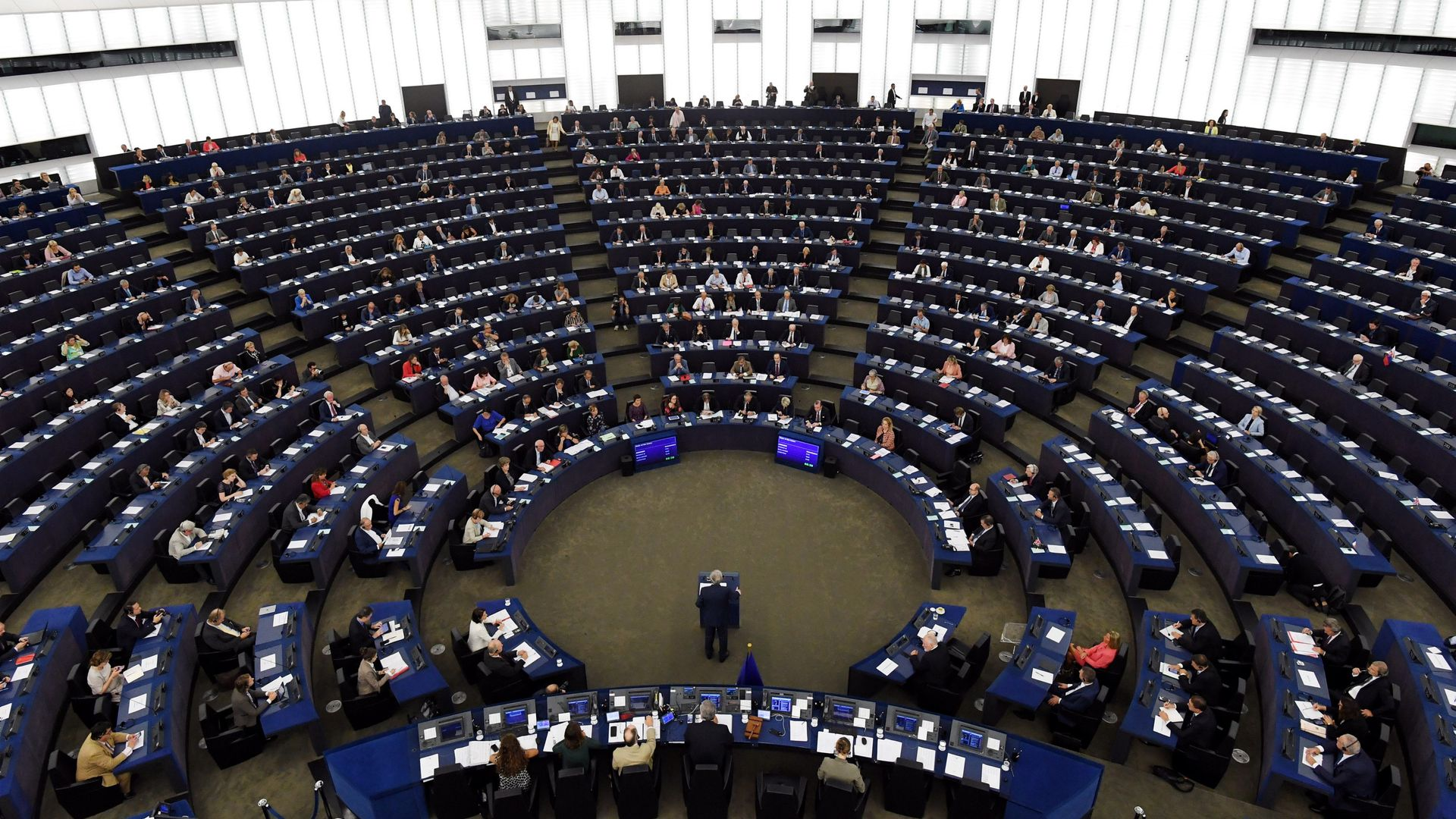 Rows of seats arranged in a circle at the European Parliament