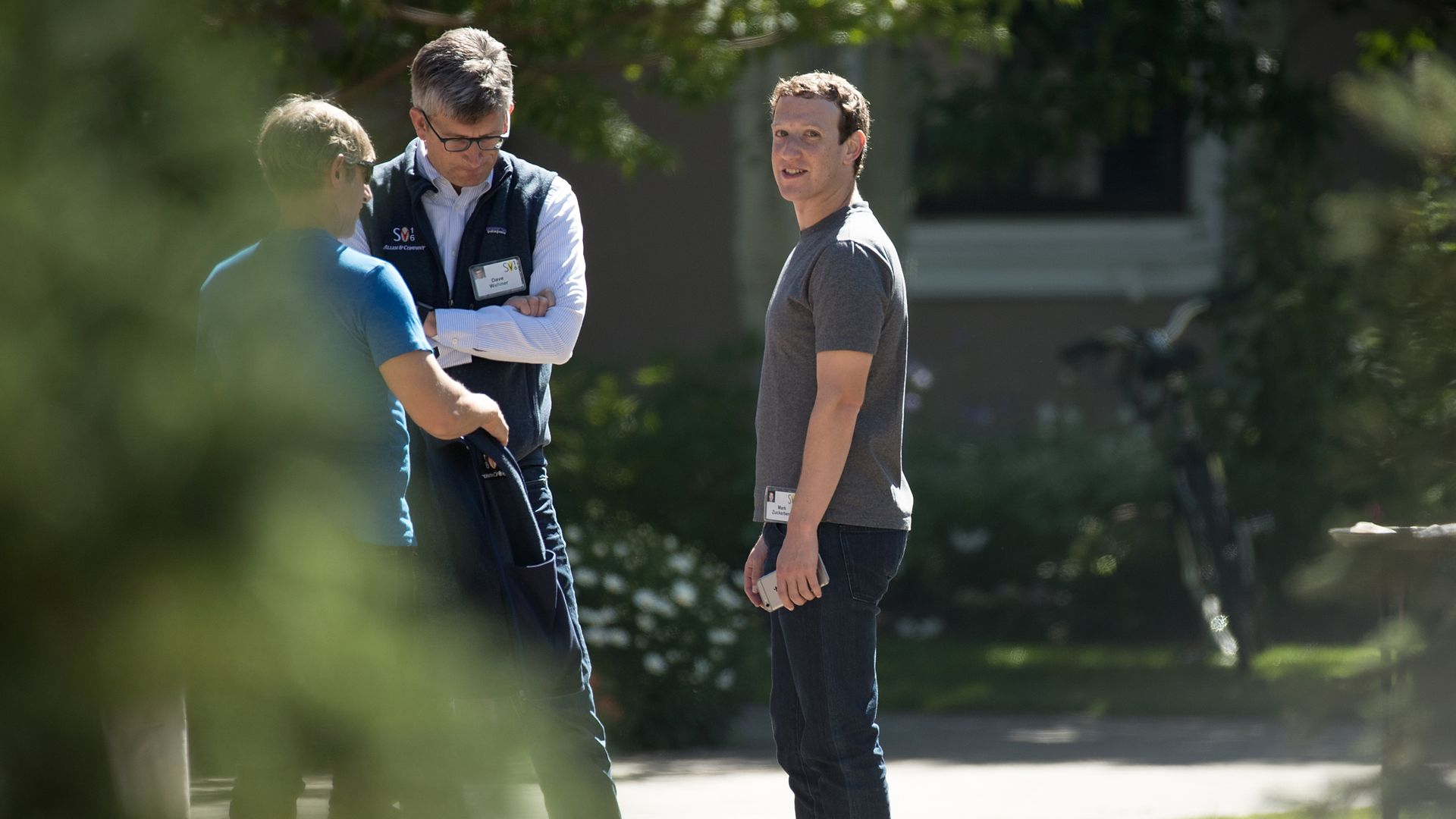 Mark Zuckberg stands with two other men