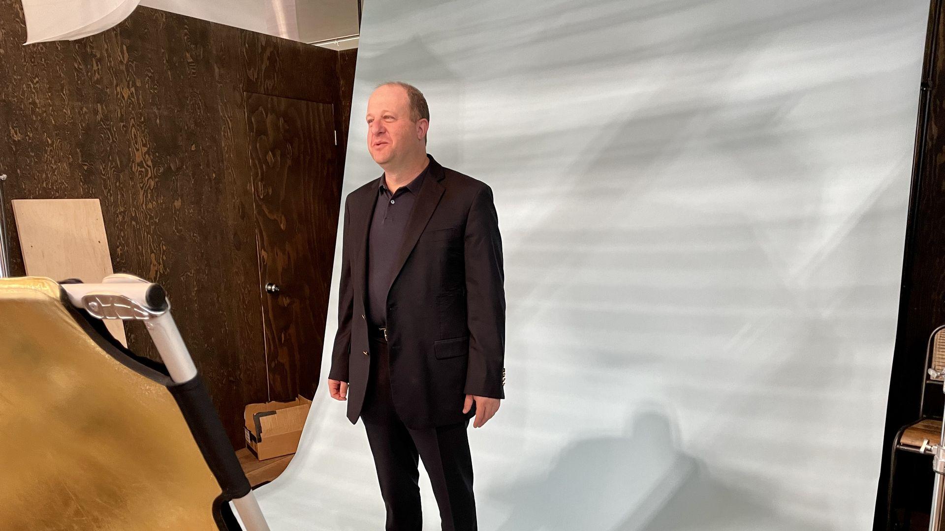 Gov. Jared Polis poses for a photo at the 2021 Outdoor Retailer show in Denver. Photo: John Frank/Axios