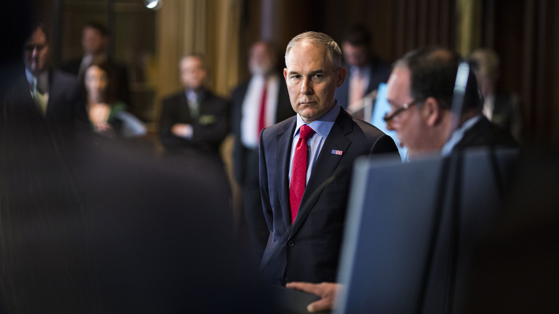 Scott Pruitt looks out the side of his eyes at a presentation.