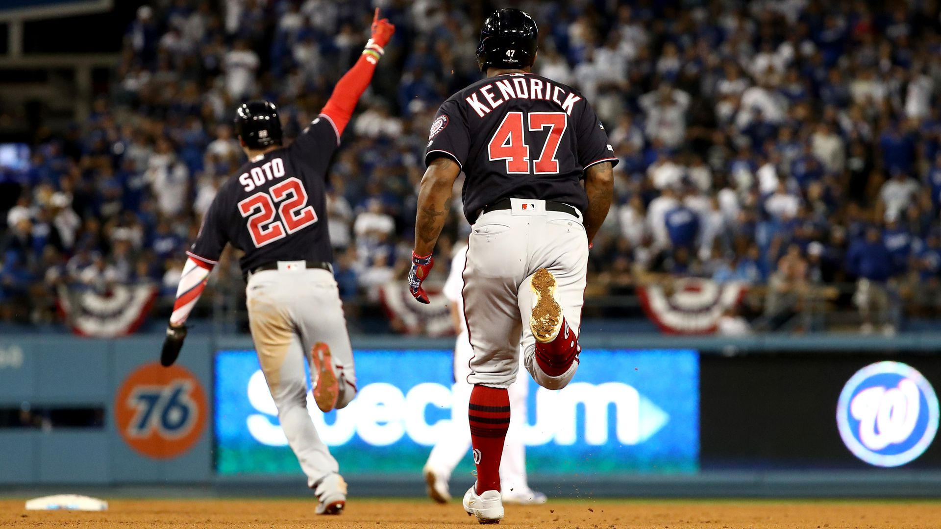 Juan Soto and Howie Kendrick rounding the bases
