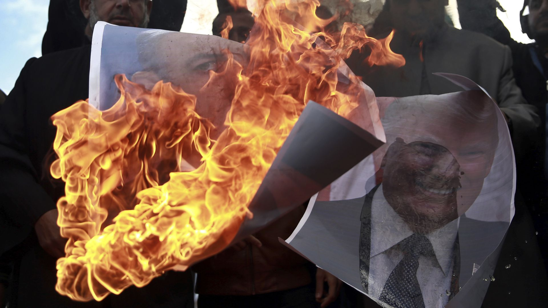 Palestinians burn pictures of Donald Trump and Israeli PM Netanyahu