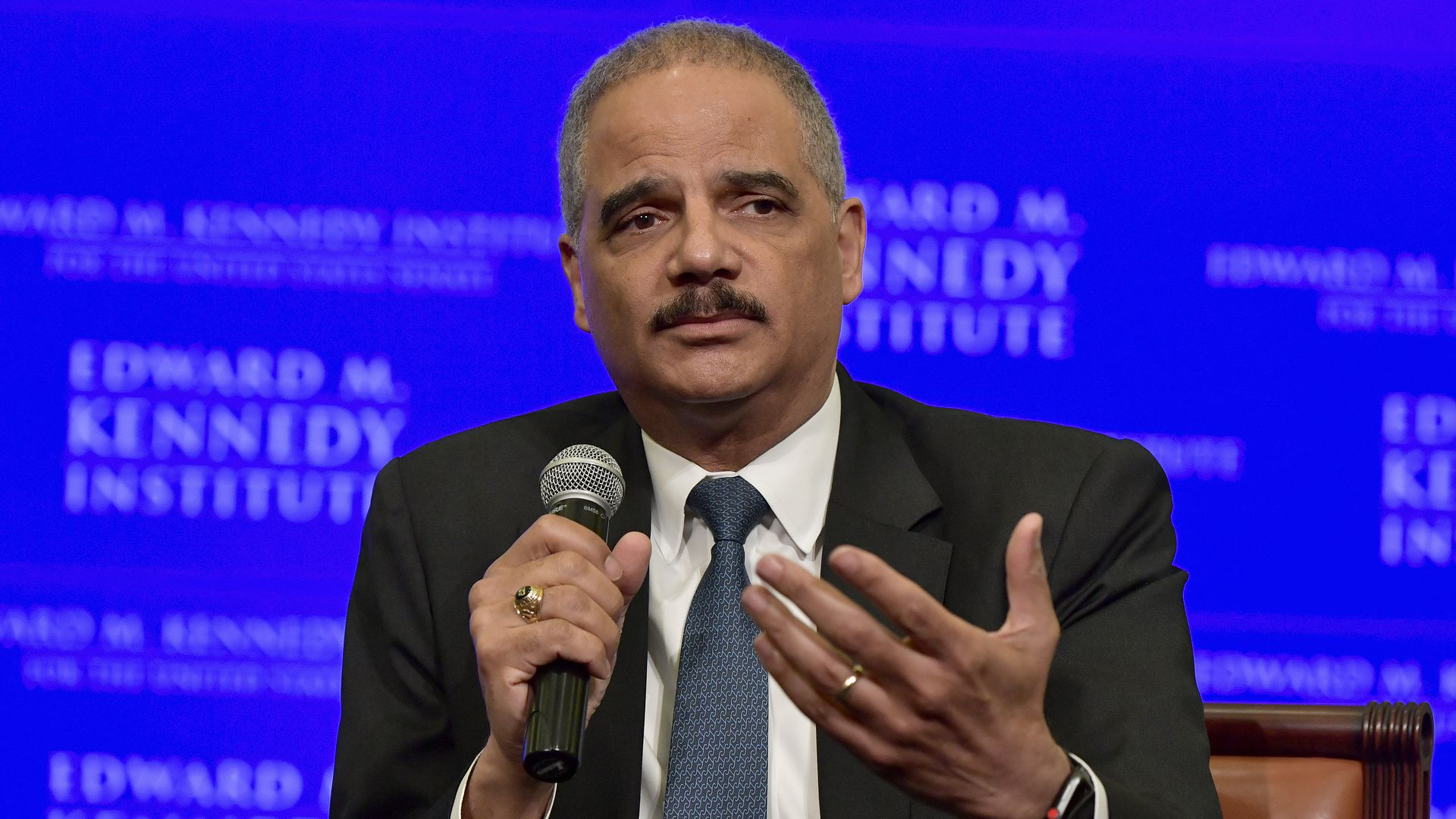 Eric Holder holding a microphone
