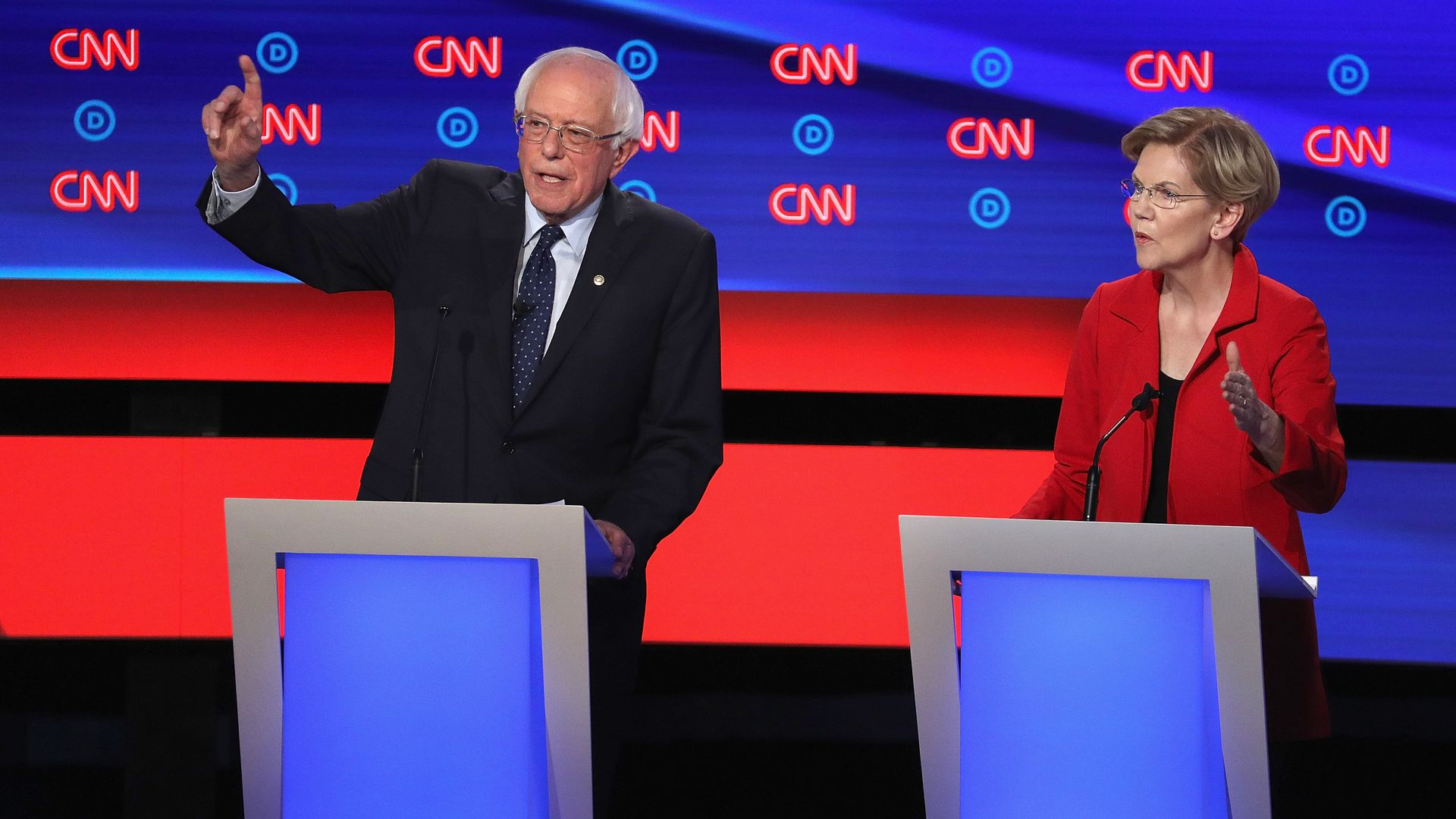 In this image, Warren and Sanders stand next to each other at two podiums on the debate stage.