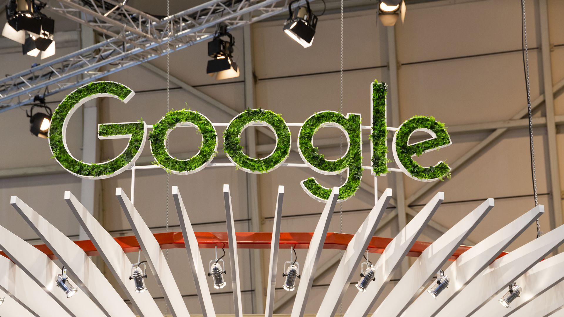 A green Google sign at a conference