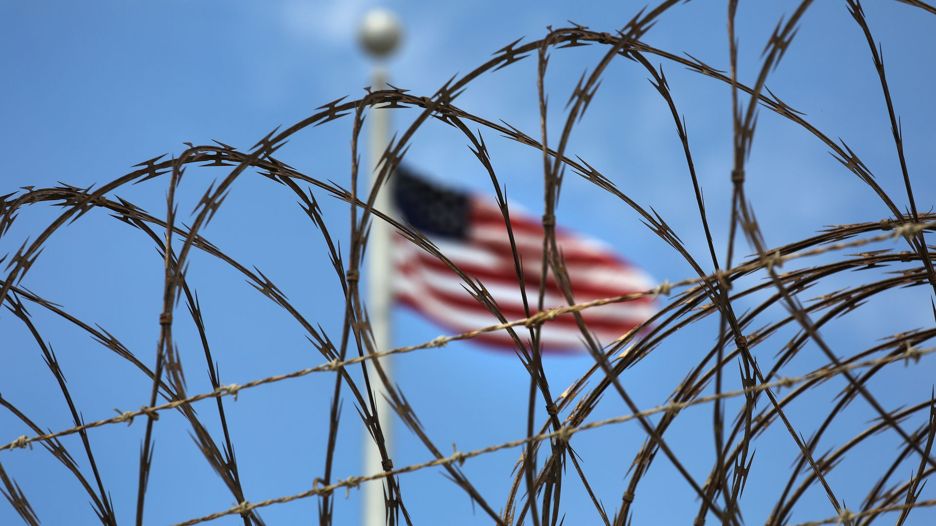 Razor wire tops the fence of the U.S. prison at Guantanamo Bay.