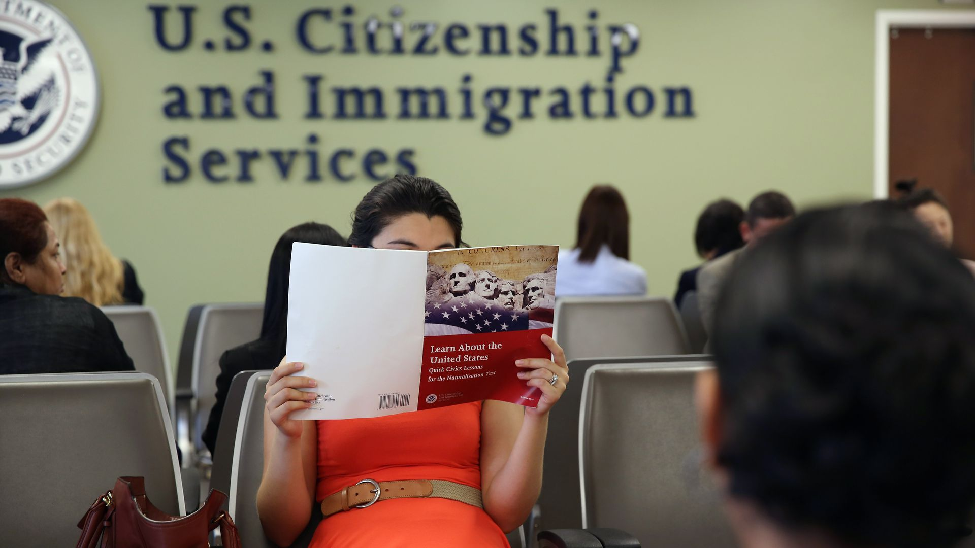 Colombian immigrant studies ahead of her citizenship exam at the U.S. Citizenship and Immigration Services (USCIS) Queens office on May 30, 2013 in New York City.