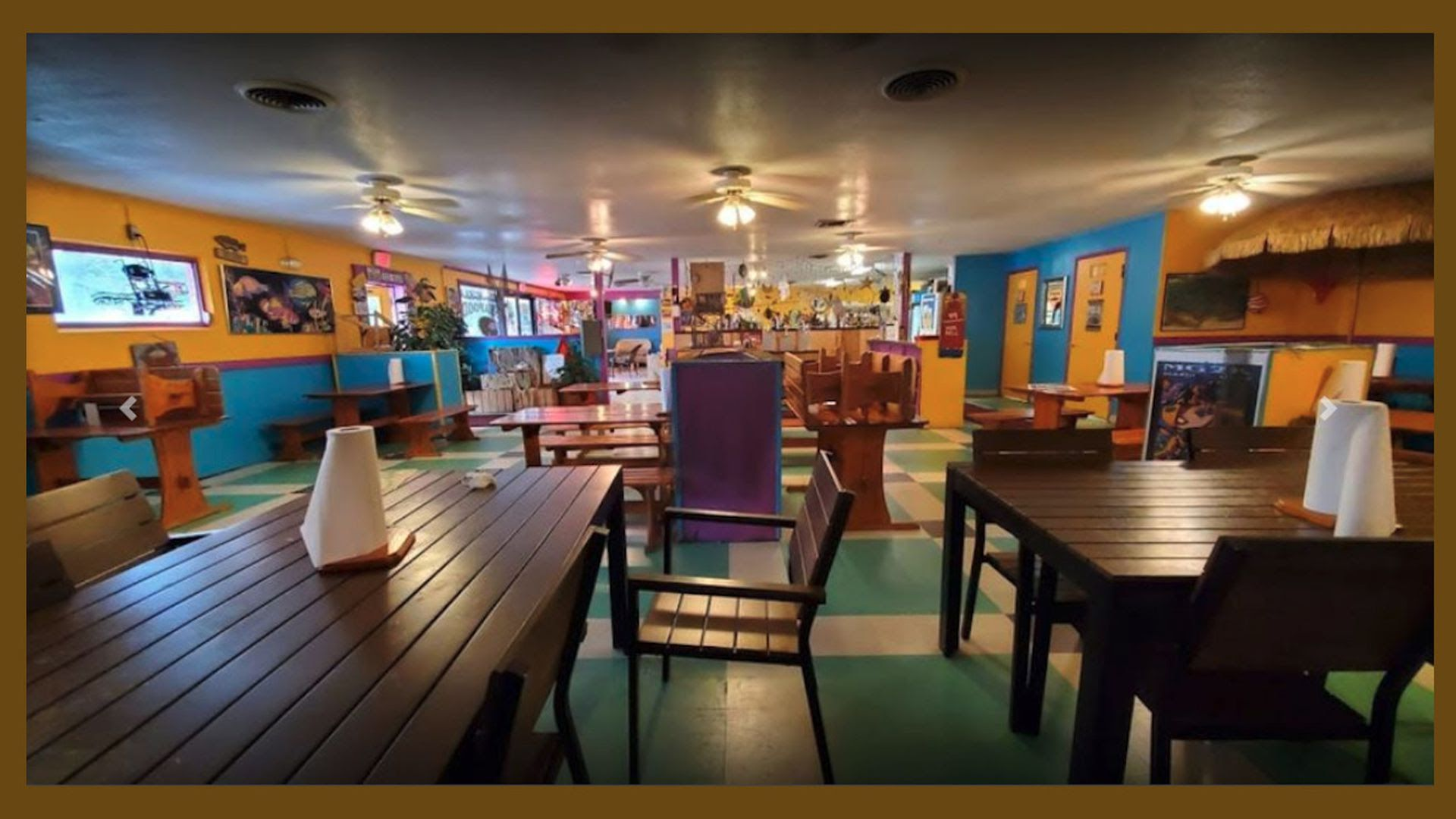 The faded blue and yellow interior of Penninsula Seafood.