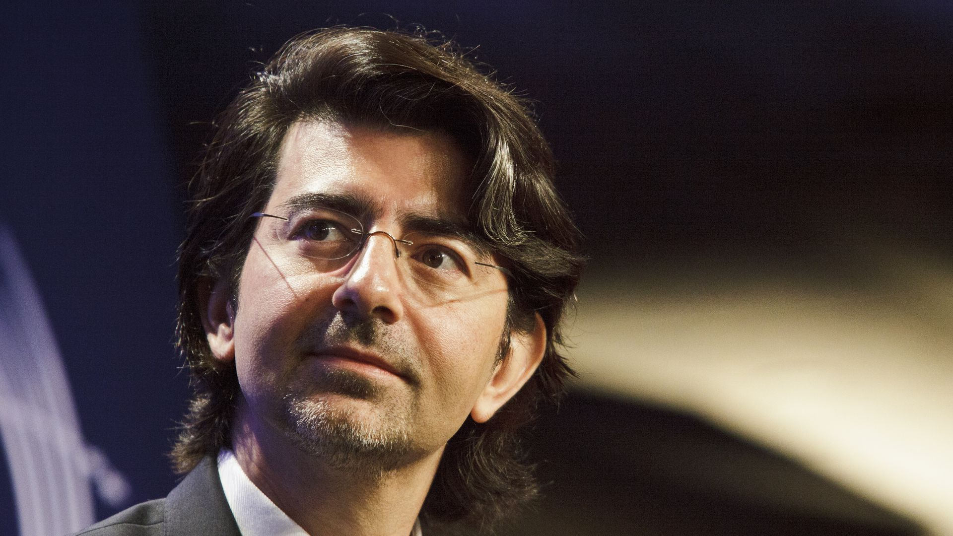 eBay founder Pierre Omidyar gazes into the distance