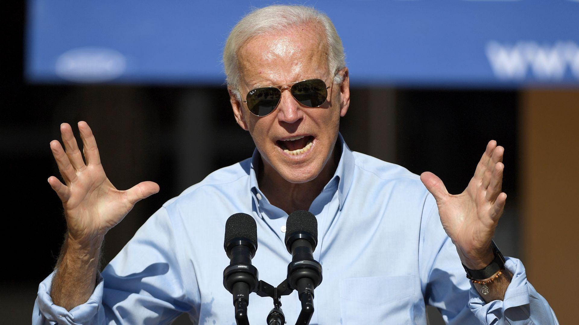 Biden with his hands up.
