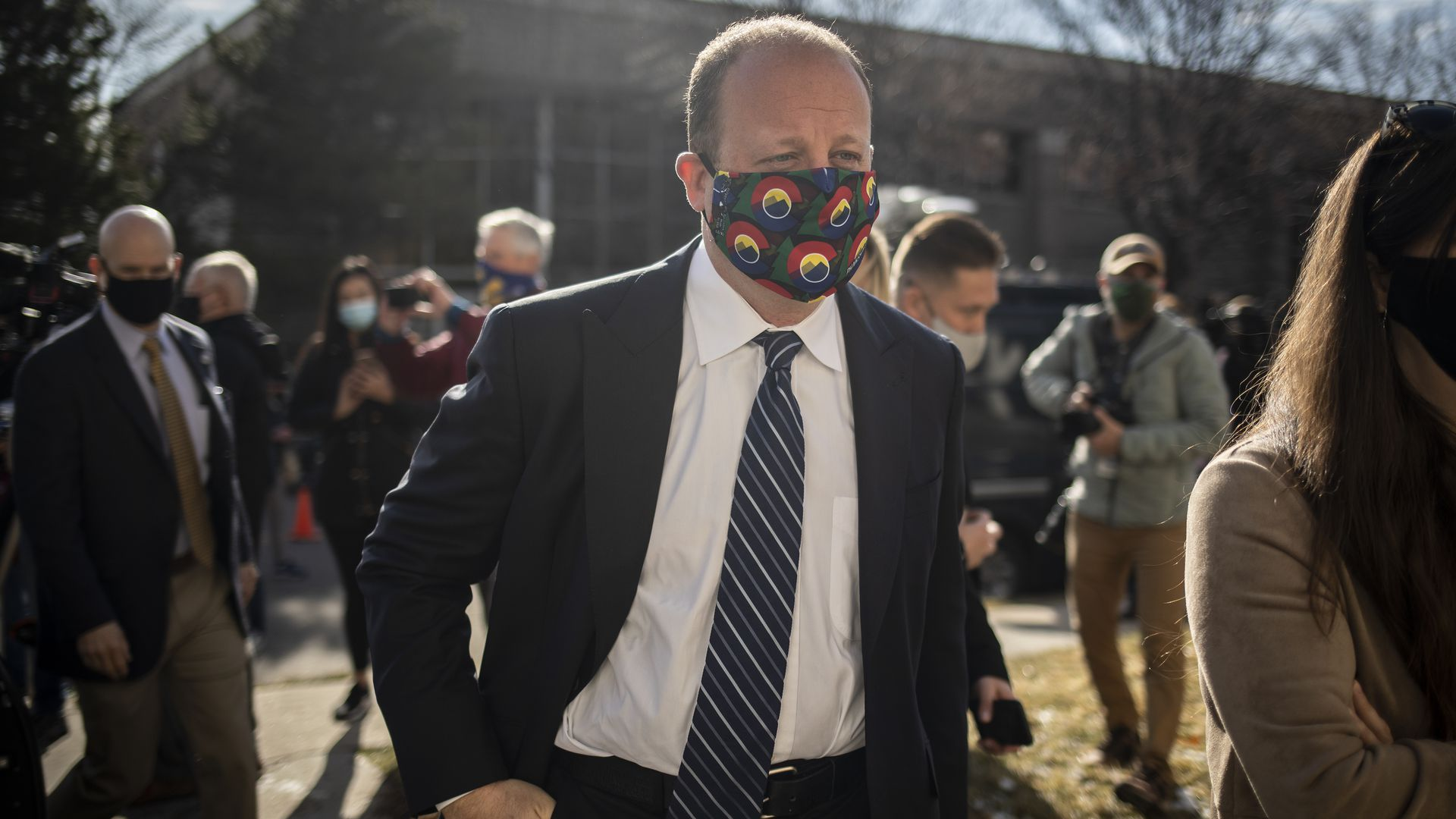 Colorado Governor Jared Polis leaves a press conference the morning after a gunman opened fire at a King Sooper's grocery store on March 23, 2021 in Boulder, Colorado.