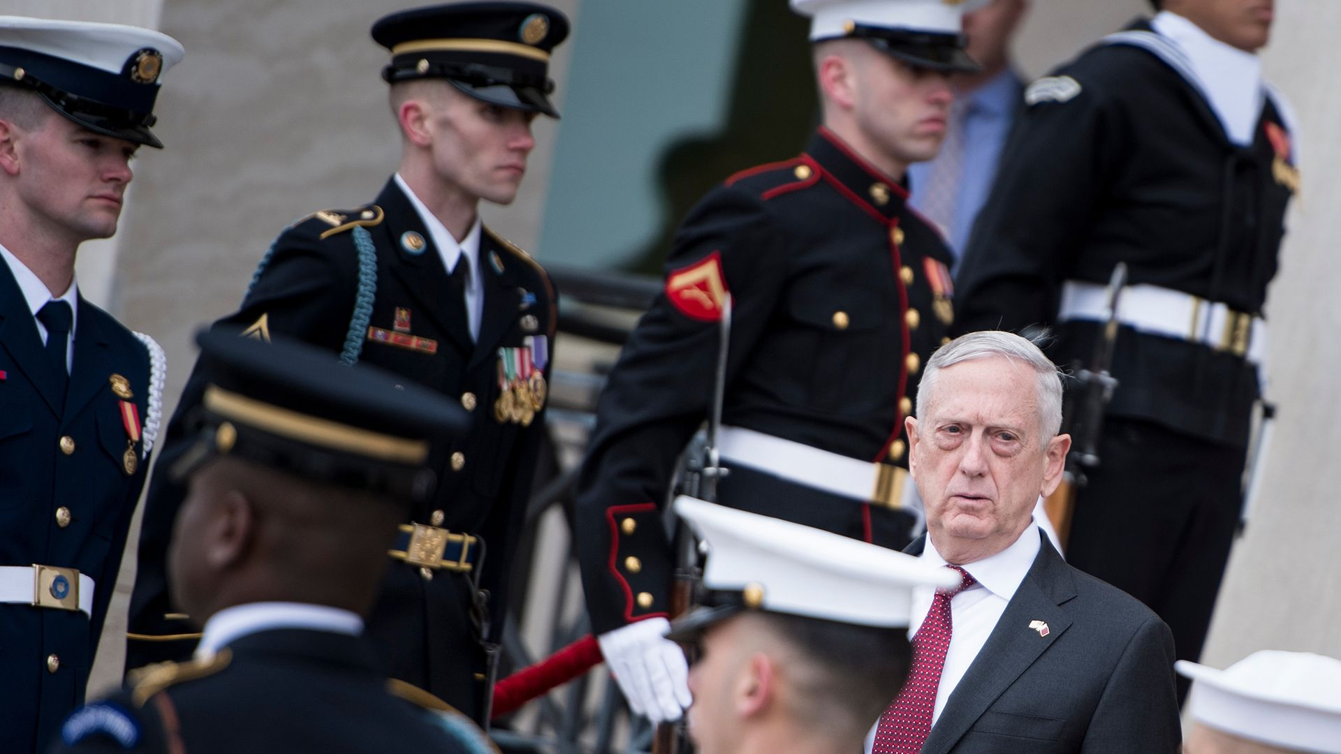 Mattis stands among soldiers