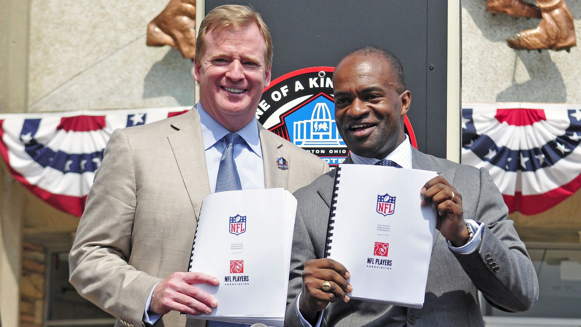 NFL commissioner Roger Goodell and NFLPA executive director Demaurice Smith after signing a new 10-year CBA in 2011. Photo: Jason Miller/Getty Images