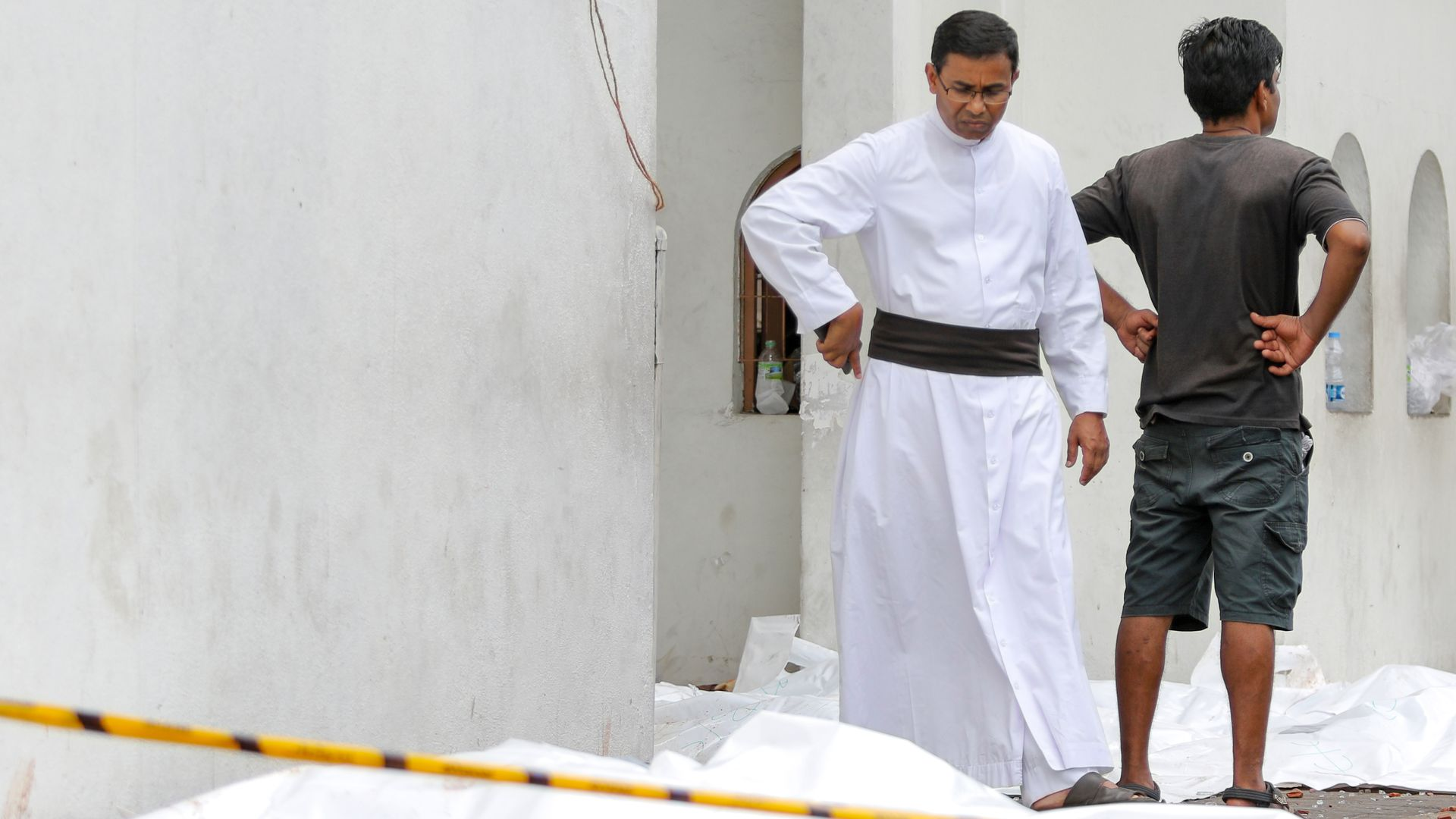 A Sri Lankan Catholic priest among the dead outside a church targeted in the attacks.