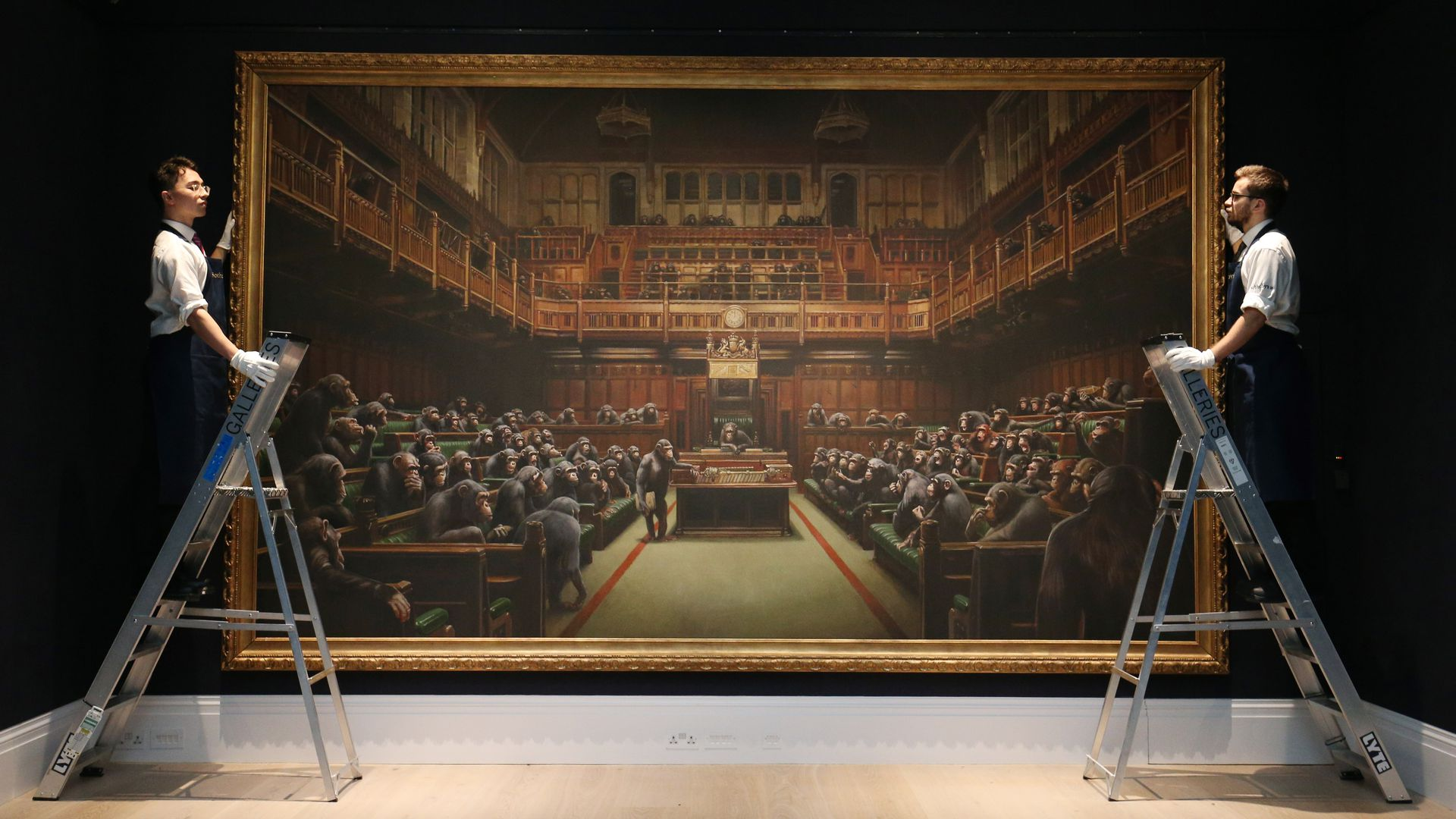 "Banksy's painting ""Devolved Parliament"" depicts chimpanzees as members of the British House of Commons."