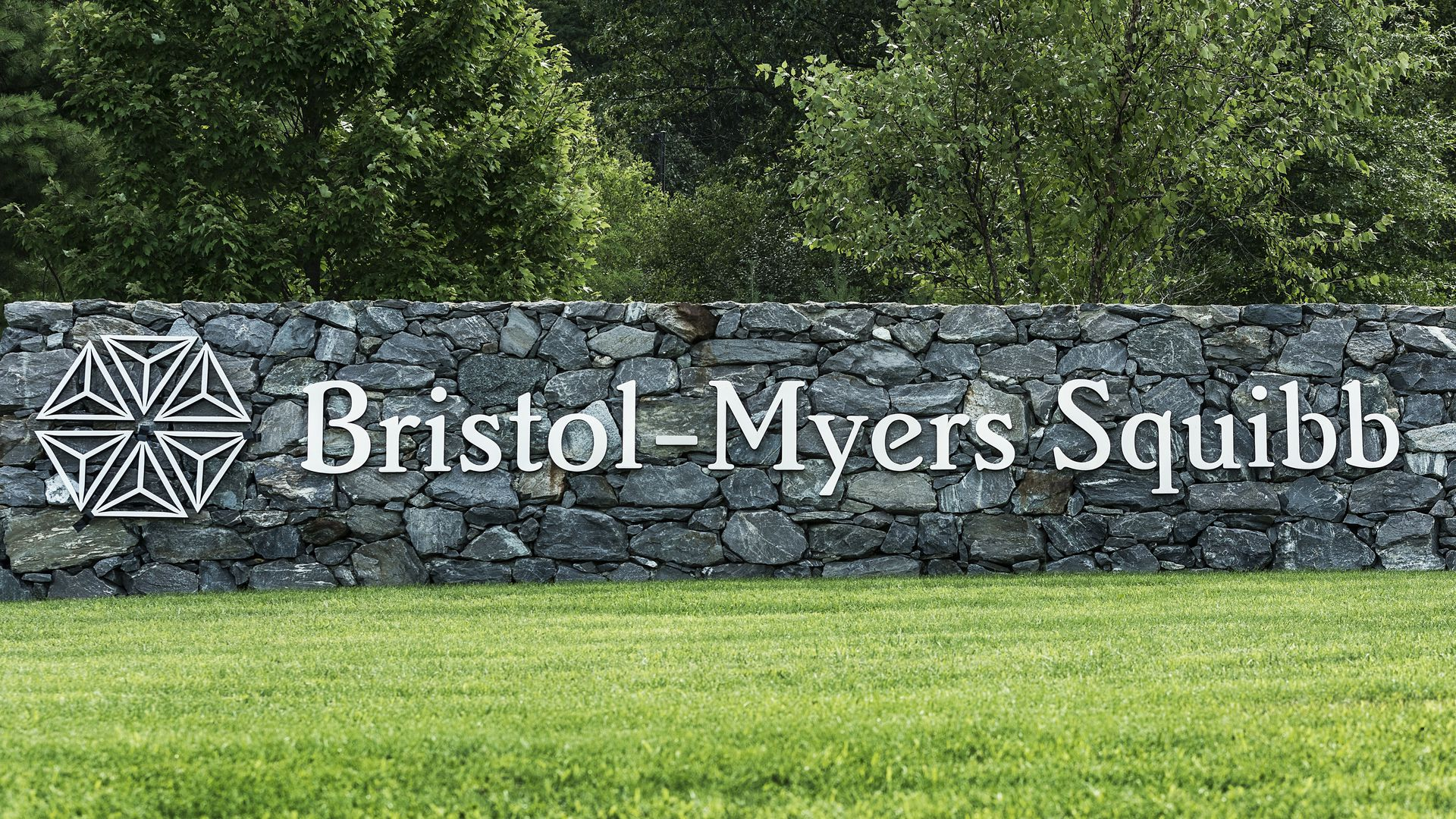 A sign with the Bristol-Myers Squibb logo
