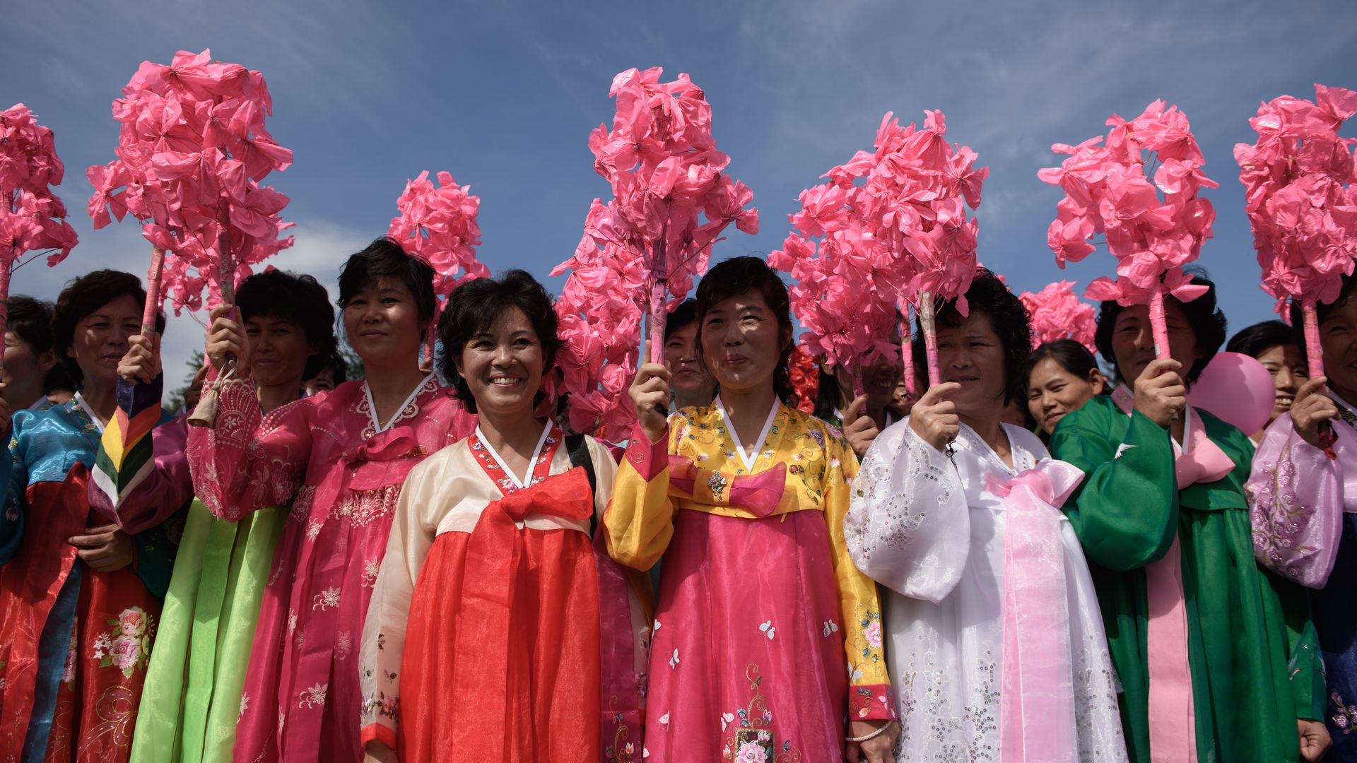 Korean women wearing colorful dresses.