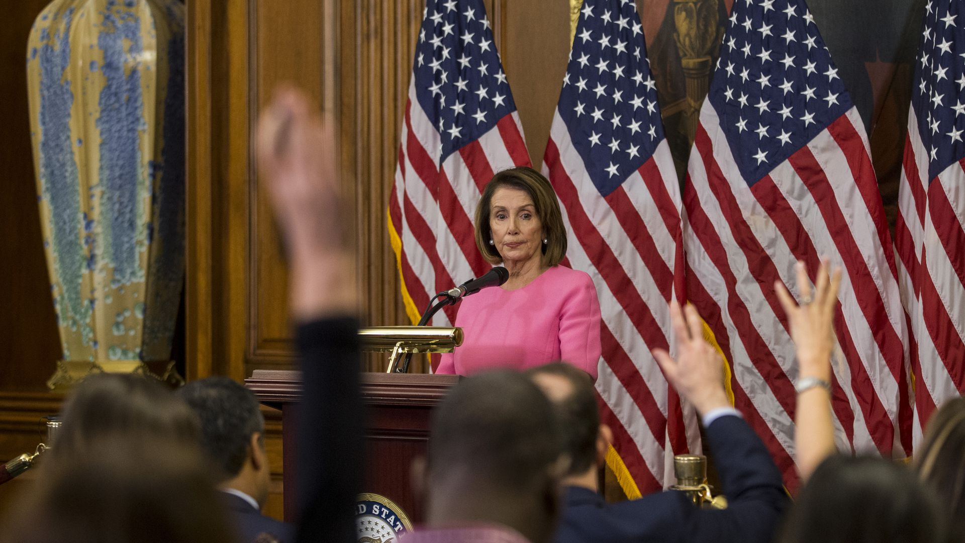 Nancy Pelosi speaking to a crowd.