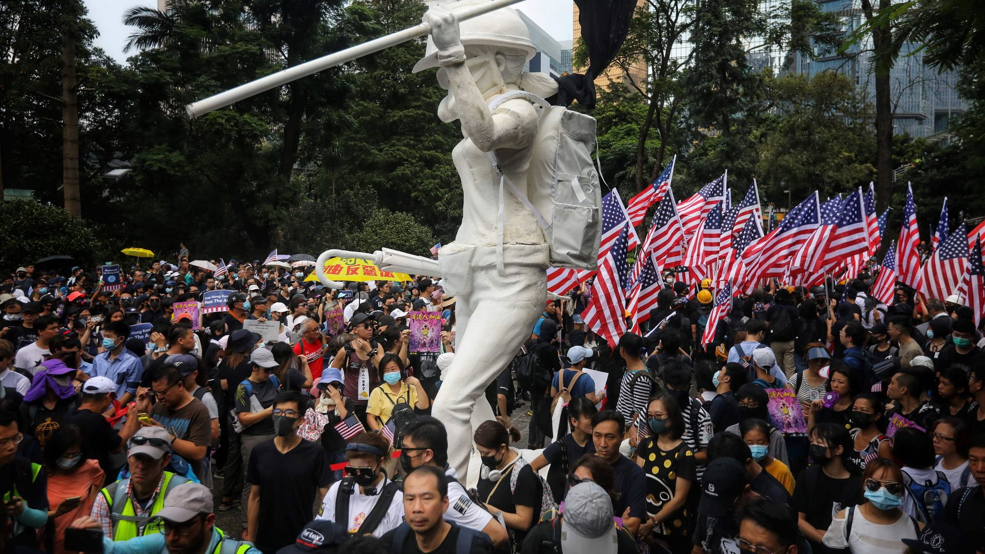 Protesters wave US national flags as they march from Chater Garden to the US consulate in Hong Kong on September 8
