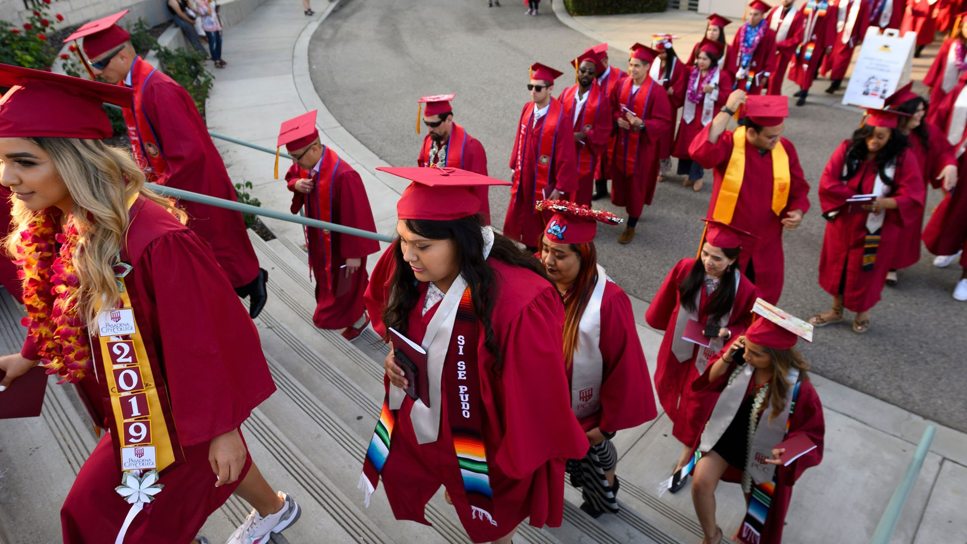 Students earning degrees at Pasadena City College participate in the graduation ceremony
