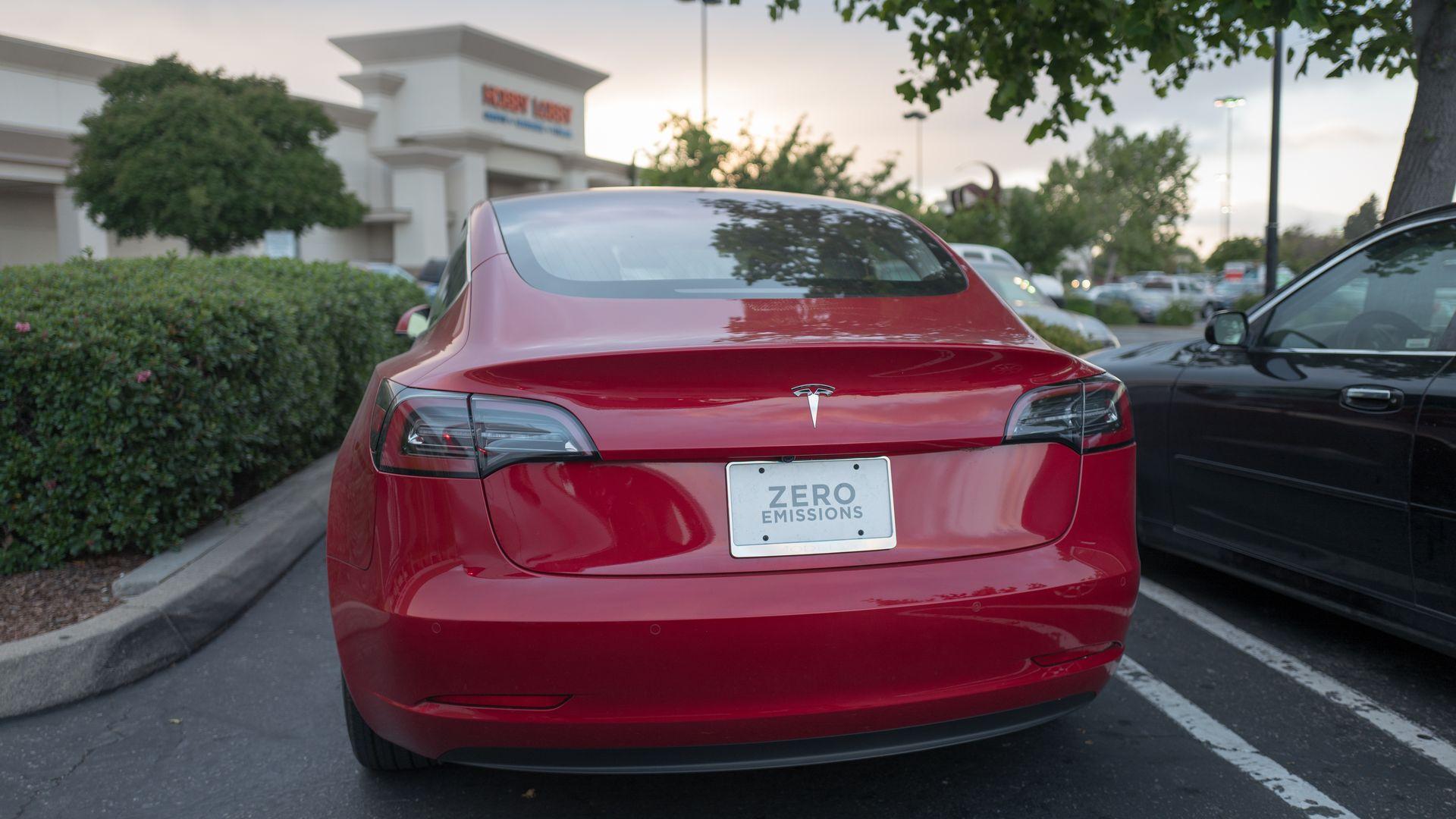 The backend of a Tesla model 3 sedan.