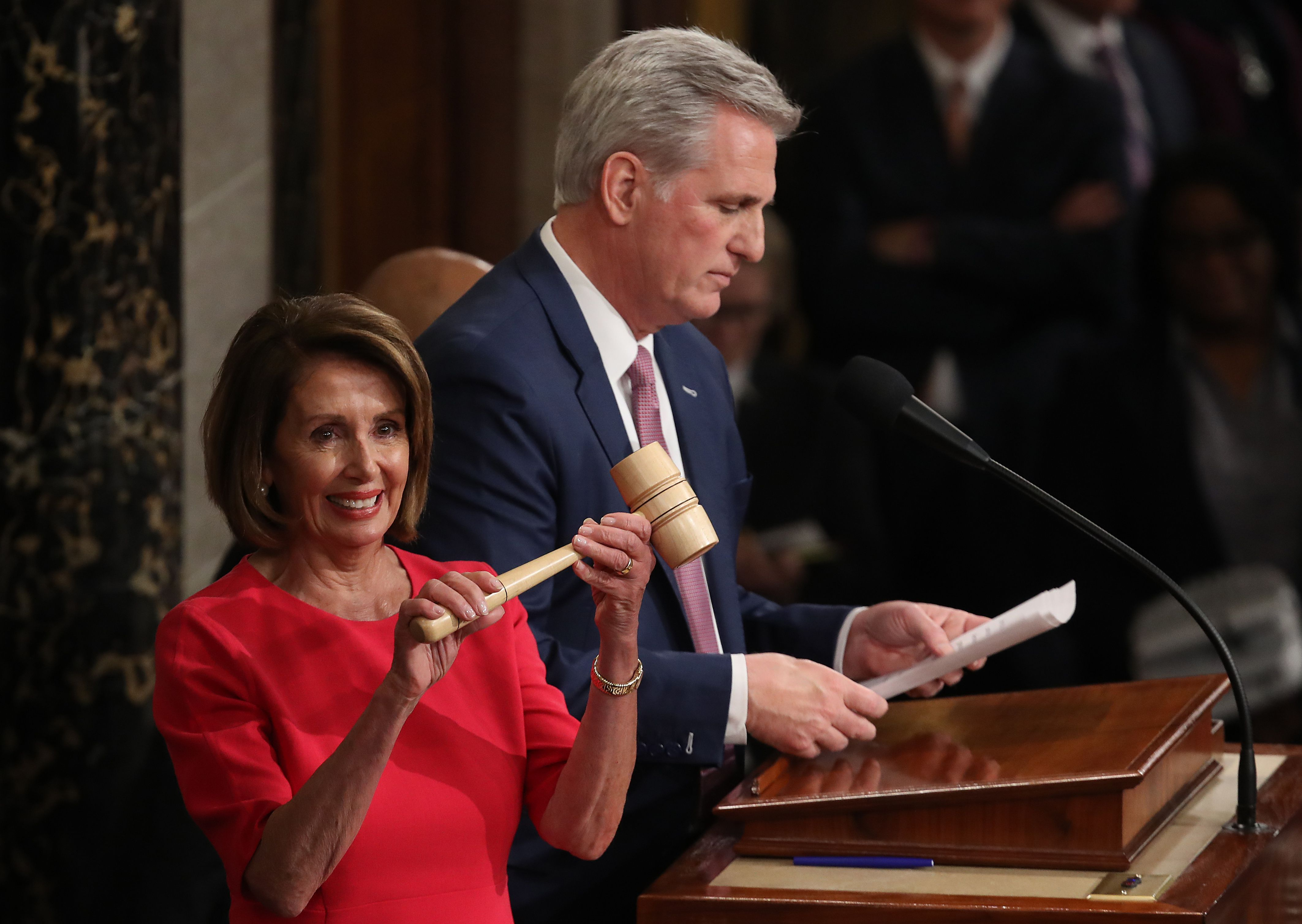 Kevin McCarthy and Nancy Pelosi as she holds the gavel.