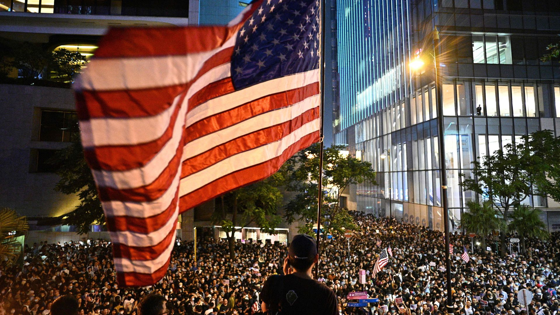 Hong Kong protestors wave US flag