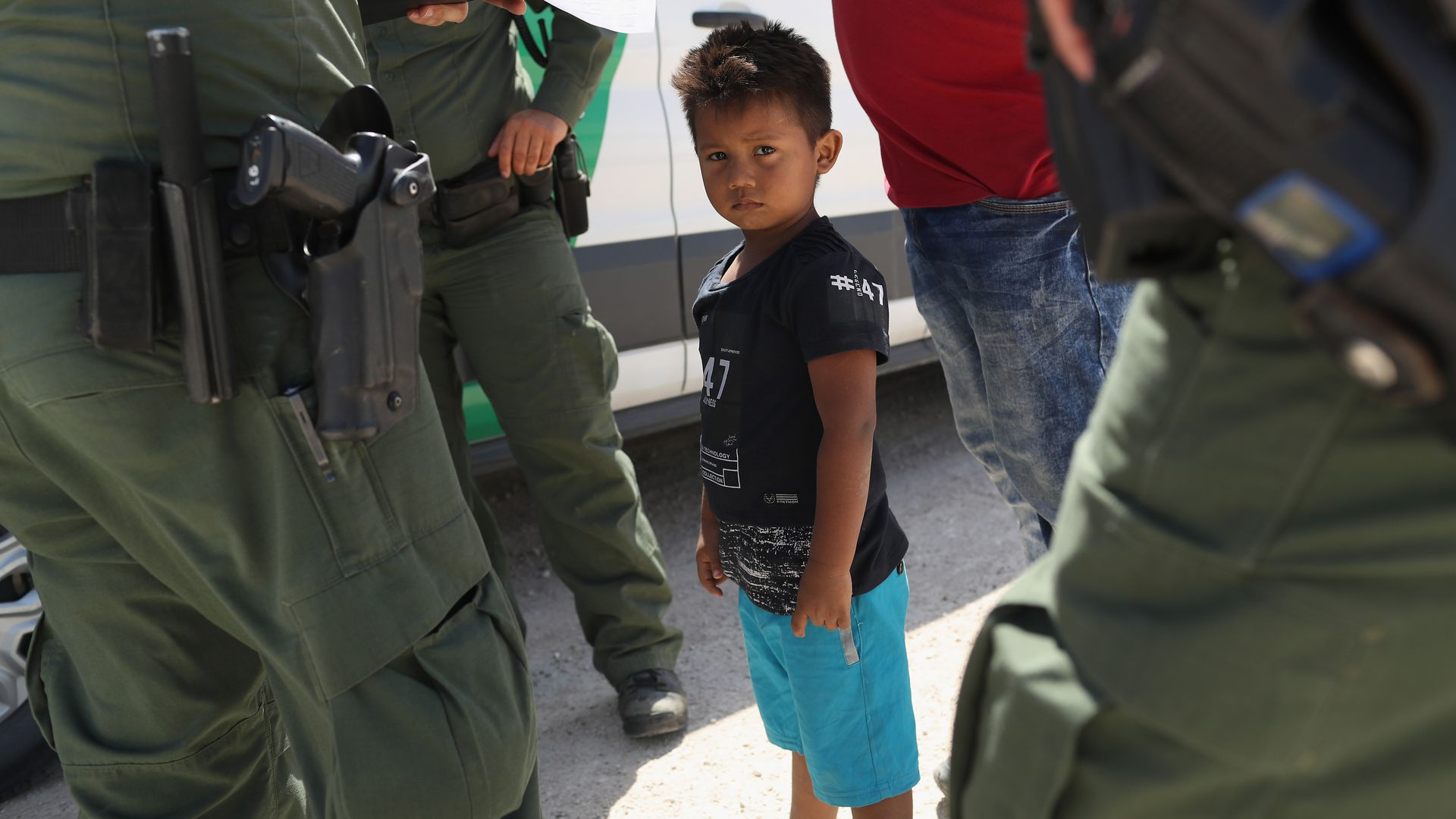 Border agents take a child into custody in Texas