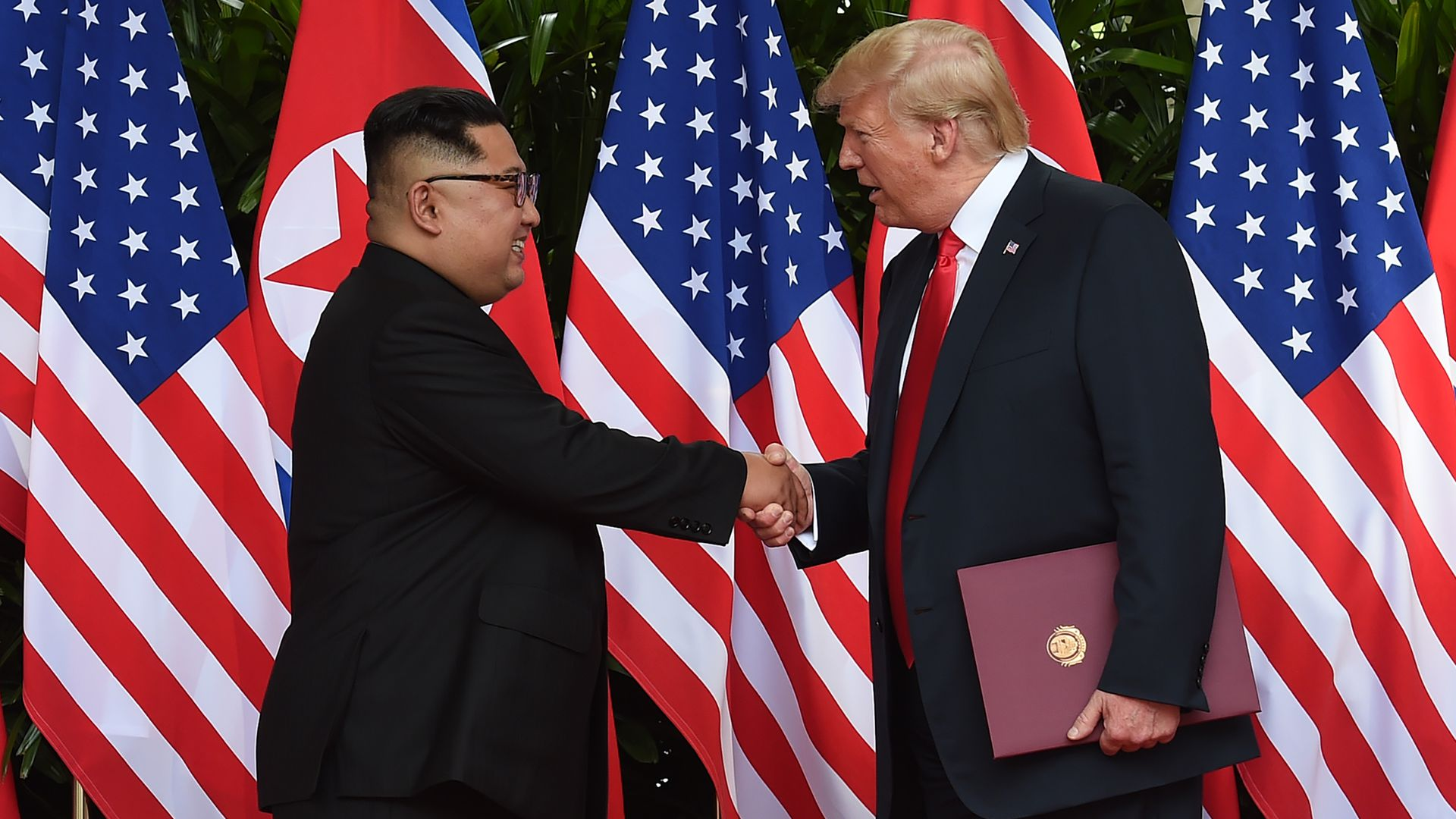 Trump and Kim shake hands at the end of the summit