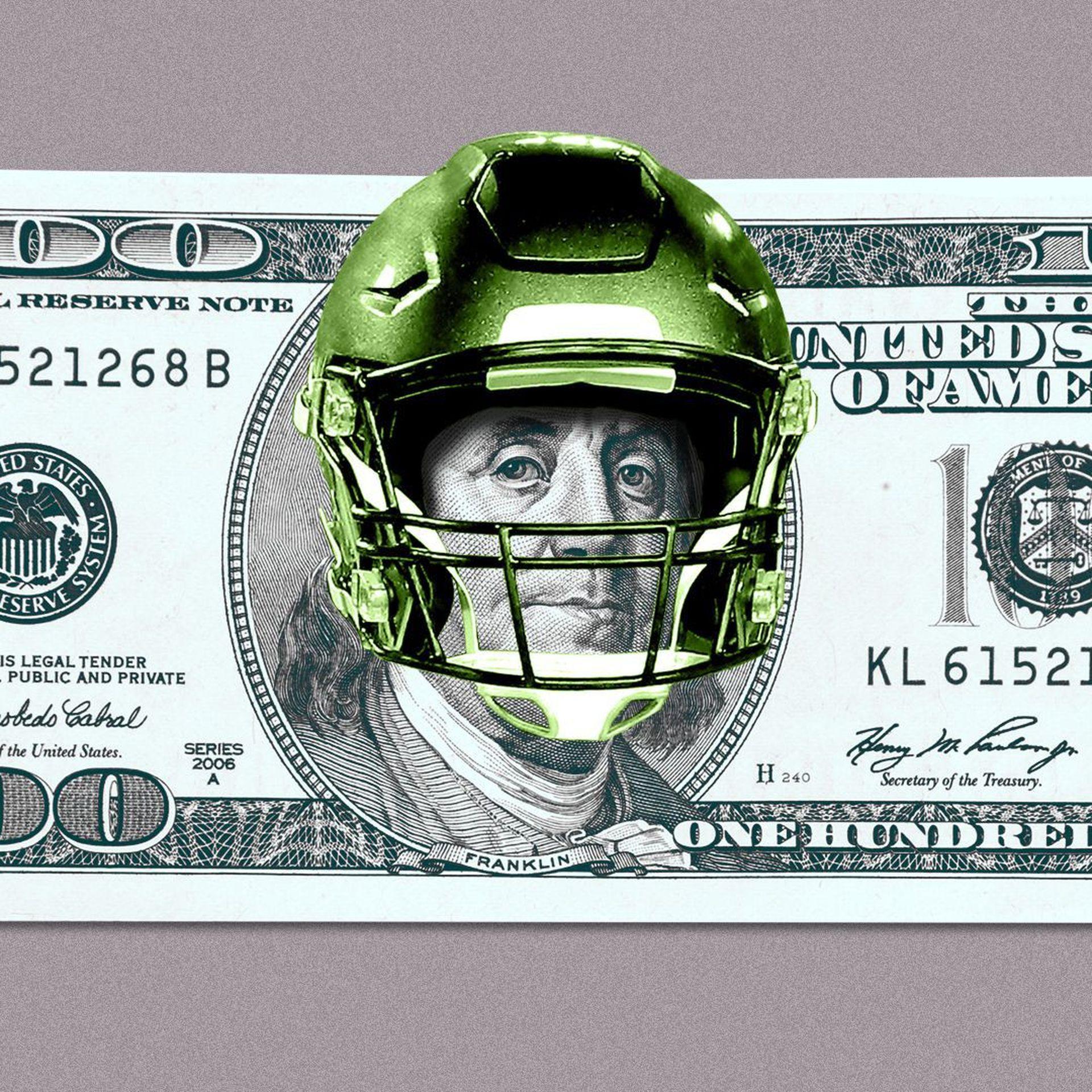 A $100 bill with a football helmet on Ben Franklin.