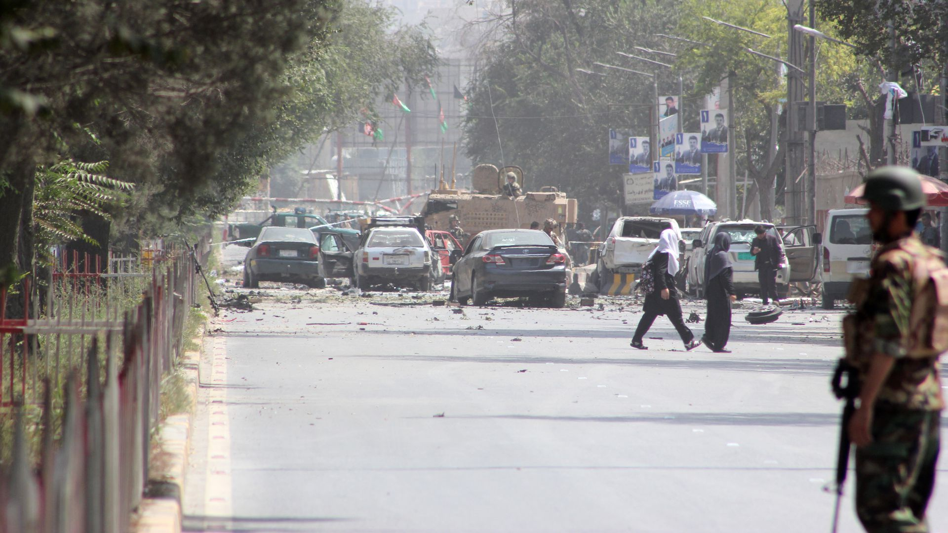 Security forces stand guard after a massive suicide car bombing rocked Afghan capital Kabul's diplomatic enclave