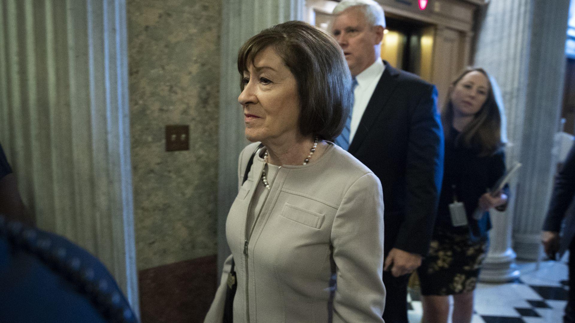 Senator Susan Collins walking