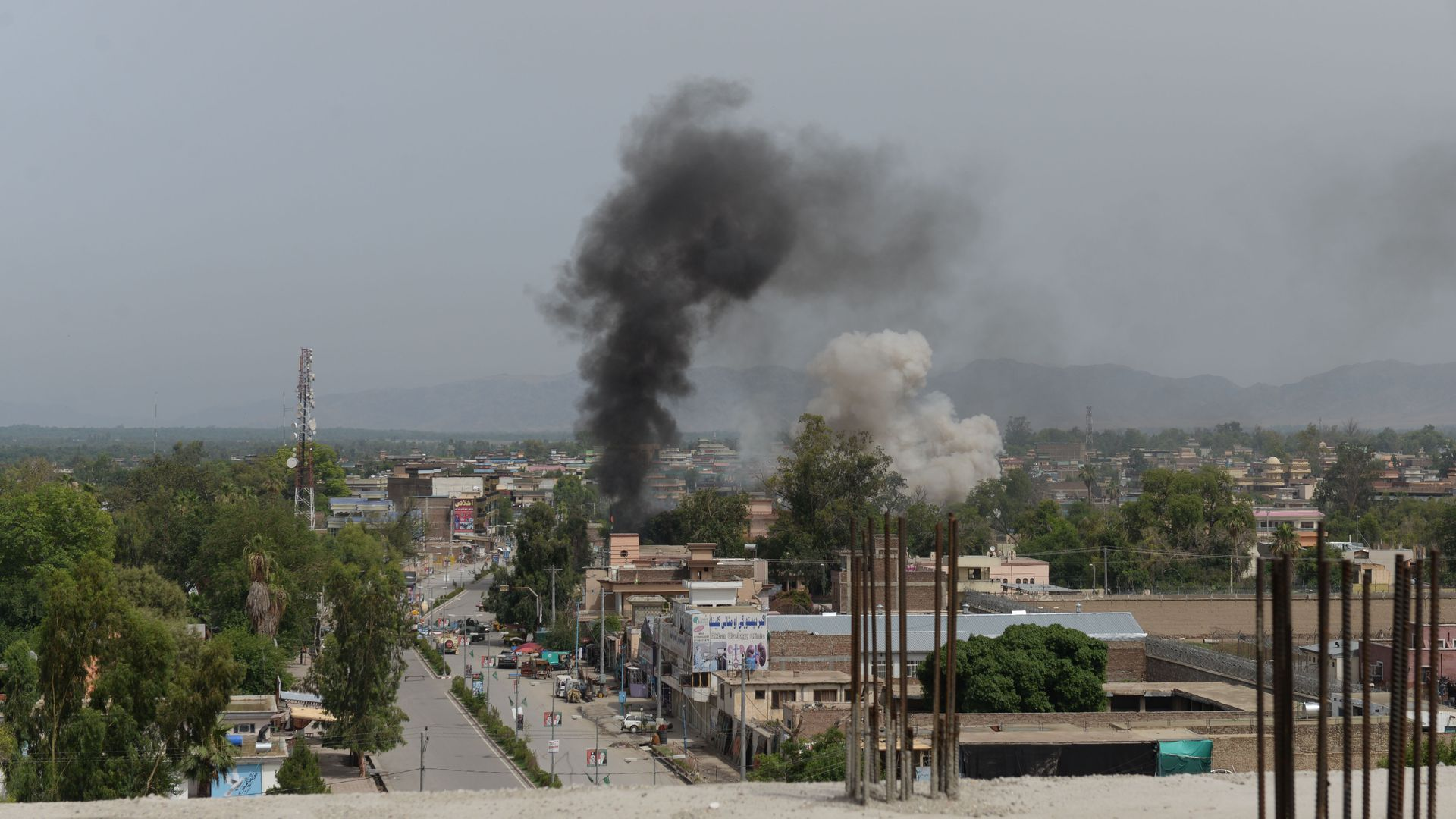 Smoke rises from a building during an ongoing attack between Afghan security force and suicide attackers at a government building in Jalalabad on May 13, 2018.