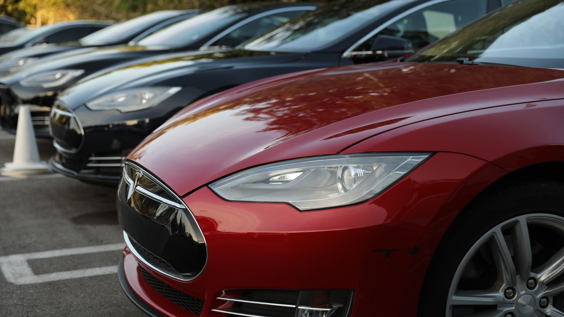 Photograph of a row of new Teslas at a dealership