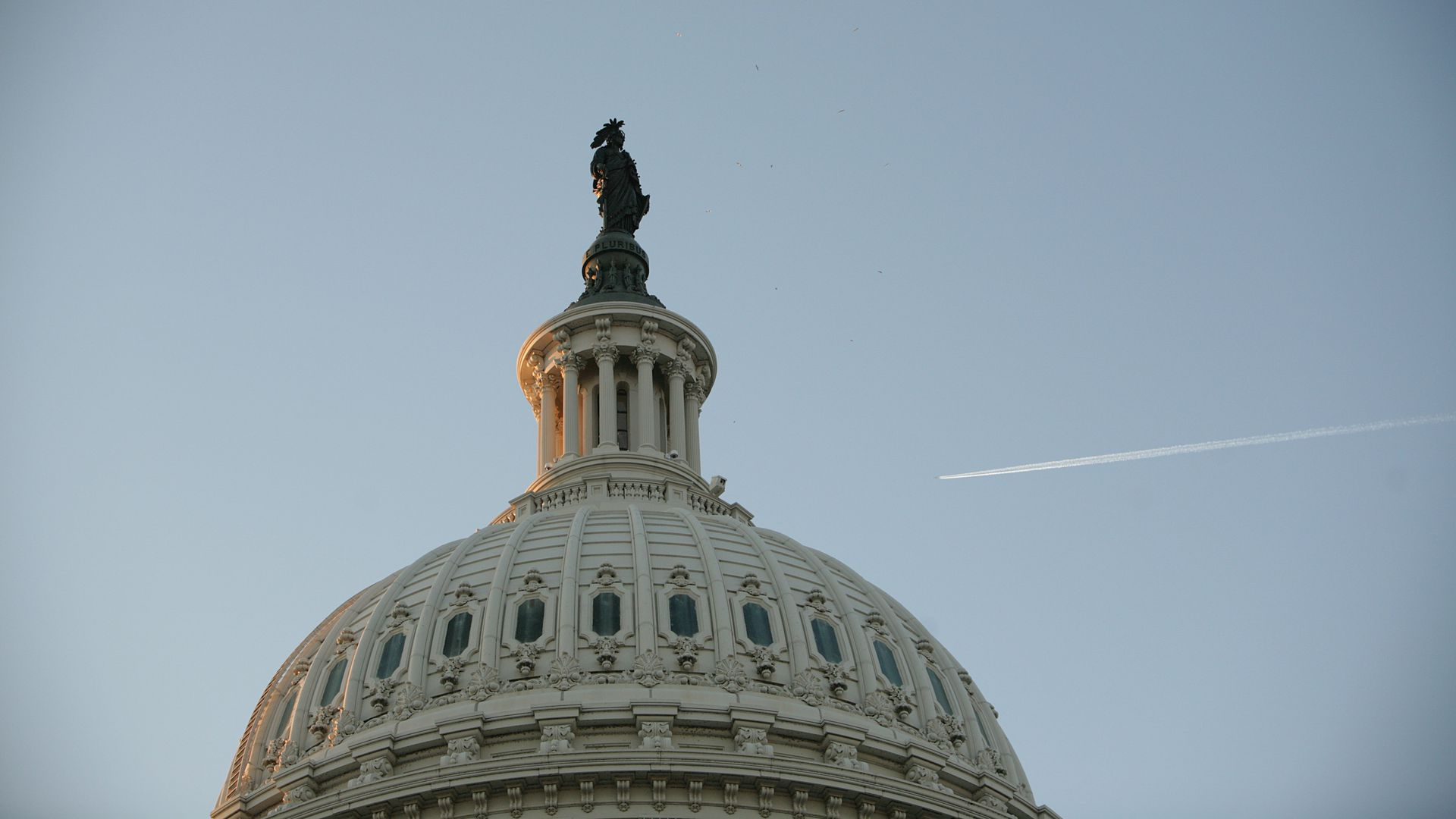 This image is a close-up of the very top of the US Capitol building.
