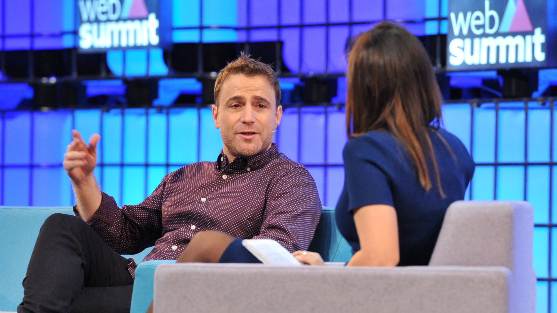 Photo of Slack CEO Stewart Butterfield speaking on conference stage.
