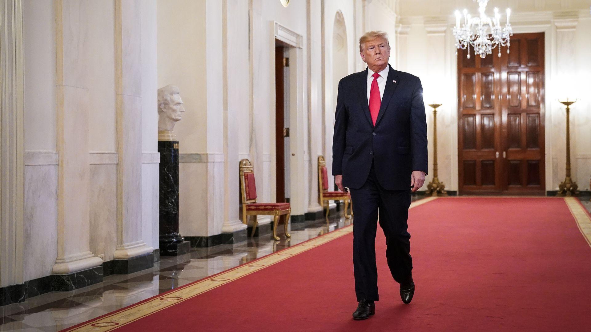 Trump walking toward the East Room