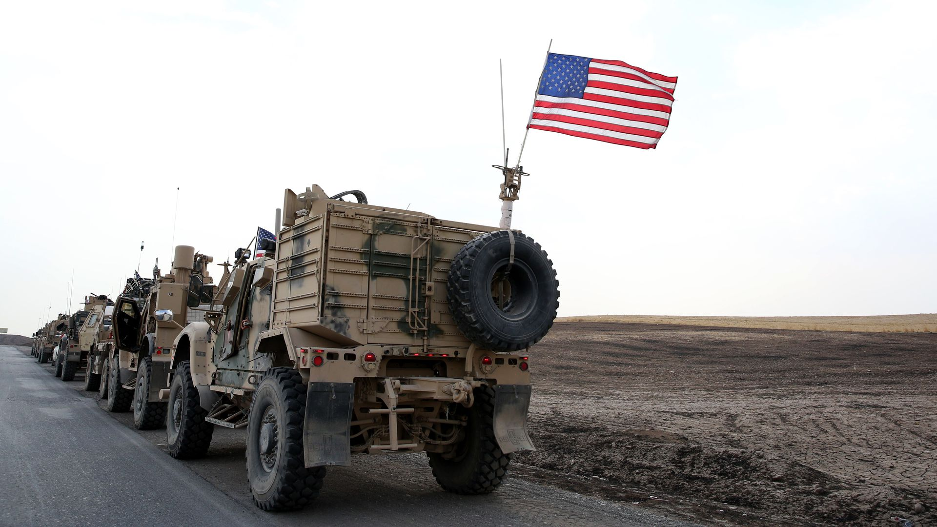A military convoy of US forces makes its way through Erbil, Iraq.