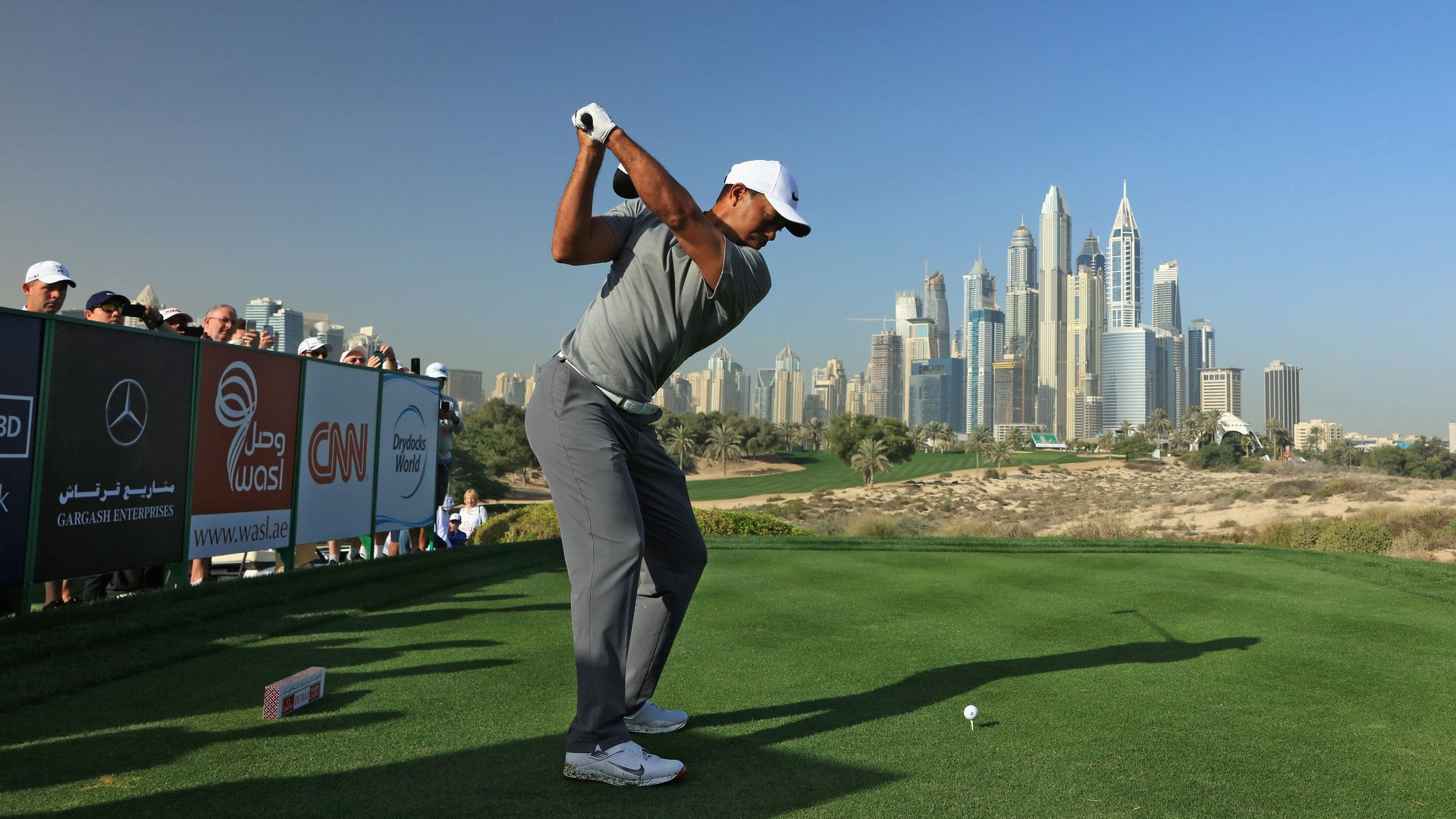Tiger Woods teeing off at Dubai's Emirates Golf Club in 2017. Photo: David Cannon/Getty Images