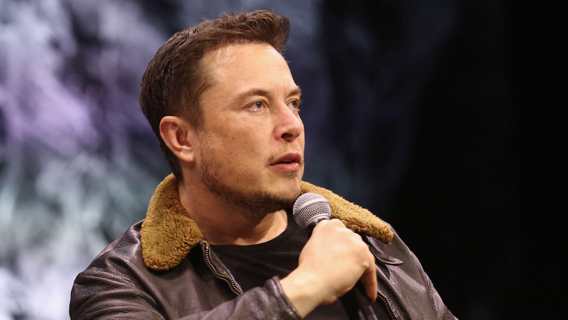 Elon Musk speaks onstage